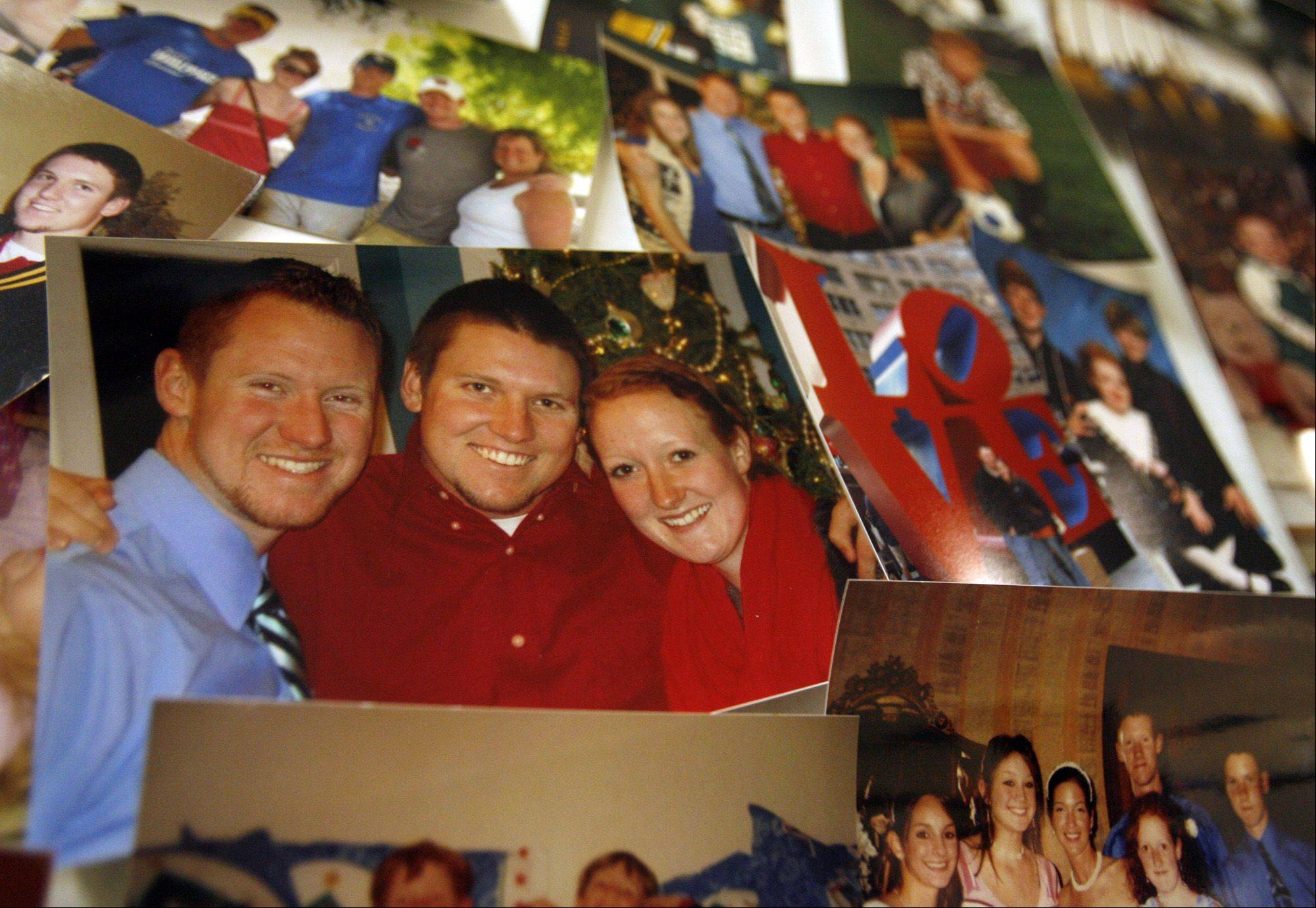 Photographs of Shaun Wild, including several with his brother Kevin and sister Shannon, on display before the memorial service.
