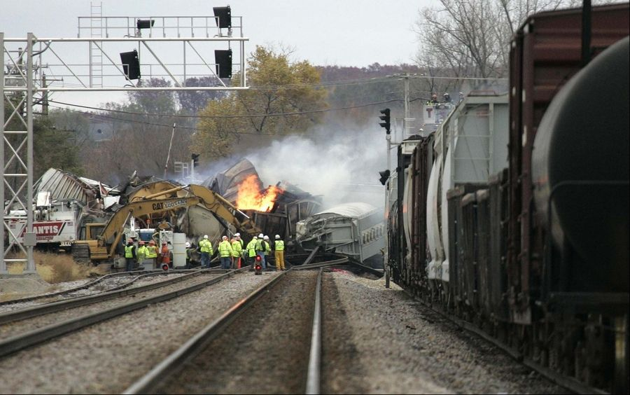 Crews look over the scene as smoke rises from a train derailment between Elgin and Bartlett Nov. 3.