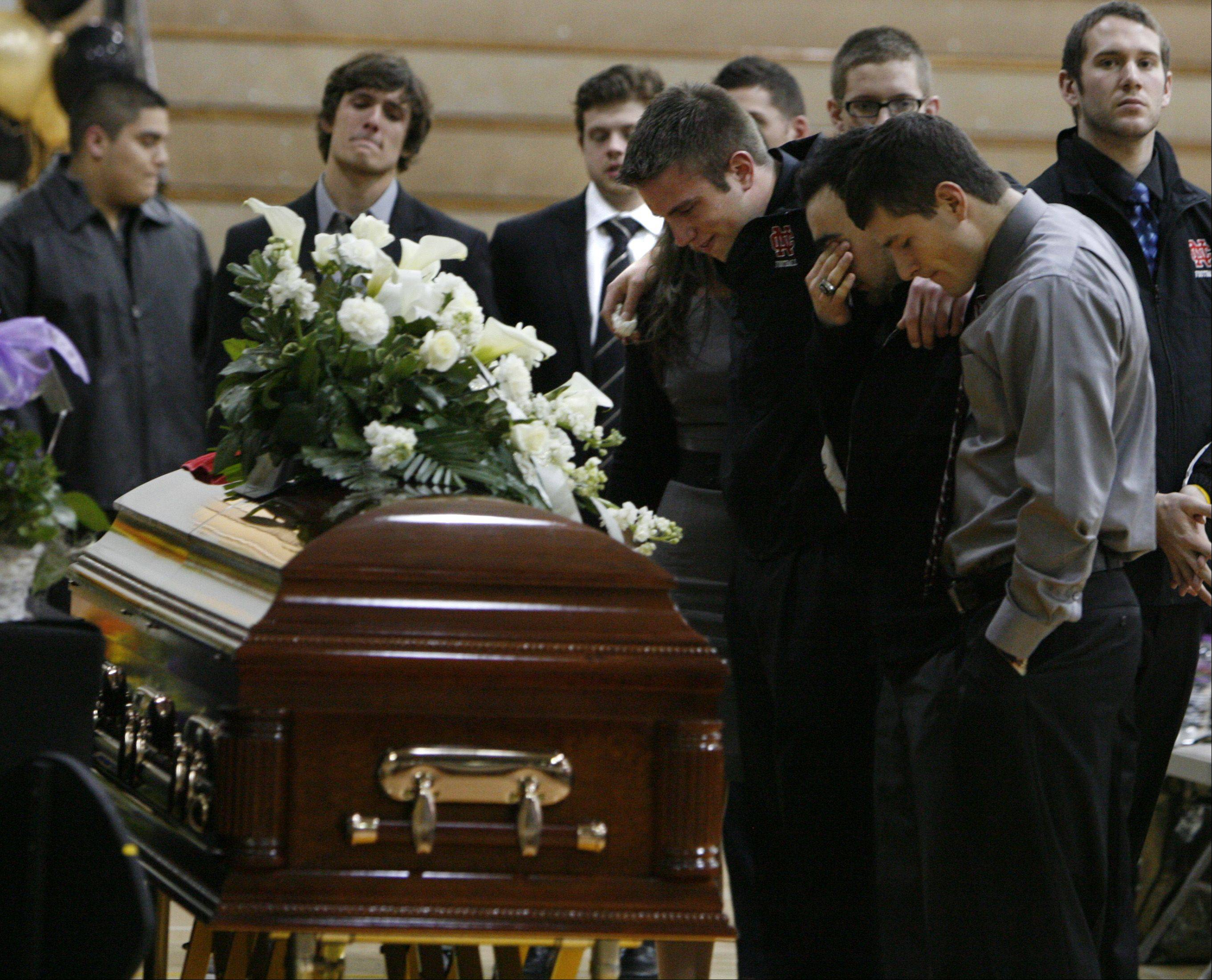 "Sports players from several Naperville area schools could not hold back tears during the ""Celebrating a Remarkable Life"" visitation and memorial service for slain Naperville teacher Shaun Wild at Brown Deer High School in Brown Deer, Wis., Thursday."