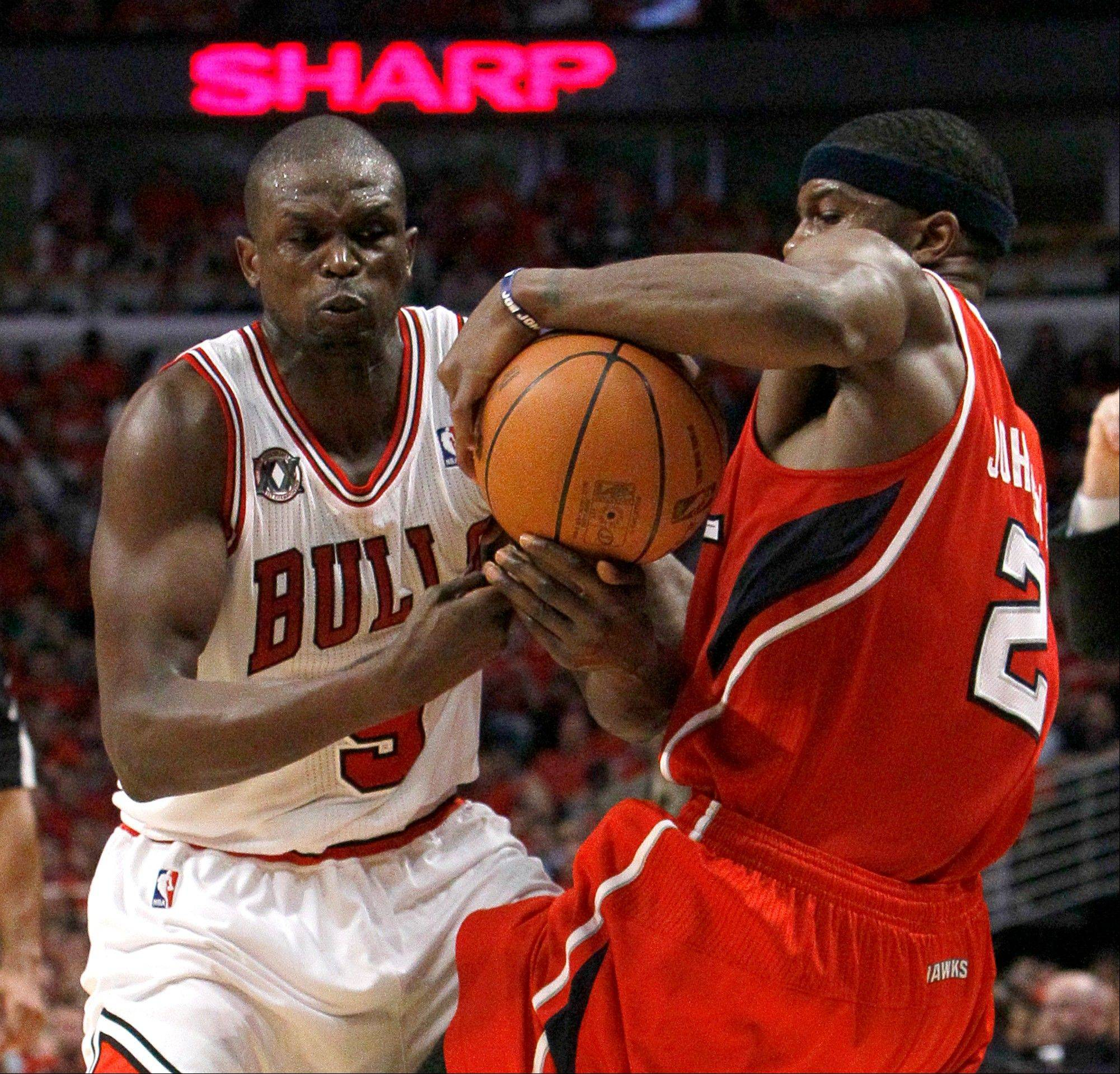Chicago Bulls forward Luol Deng, left, strips Atlanta Hawks guard Joe Johnson of the ball during the third quarter in Game 5 of a second-round NBA playoff basketball series Tuesday, May 10, 2011, in Chicago. The Bulls won 95-83, and lead the series 3-2.