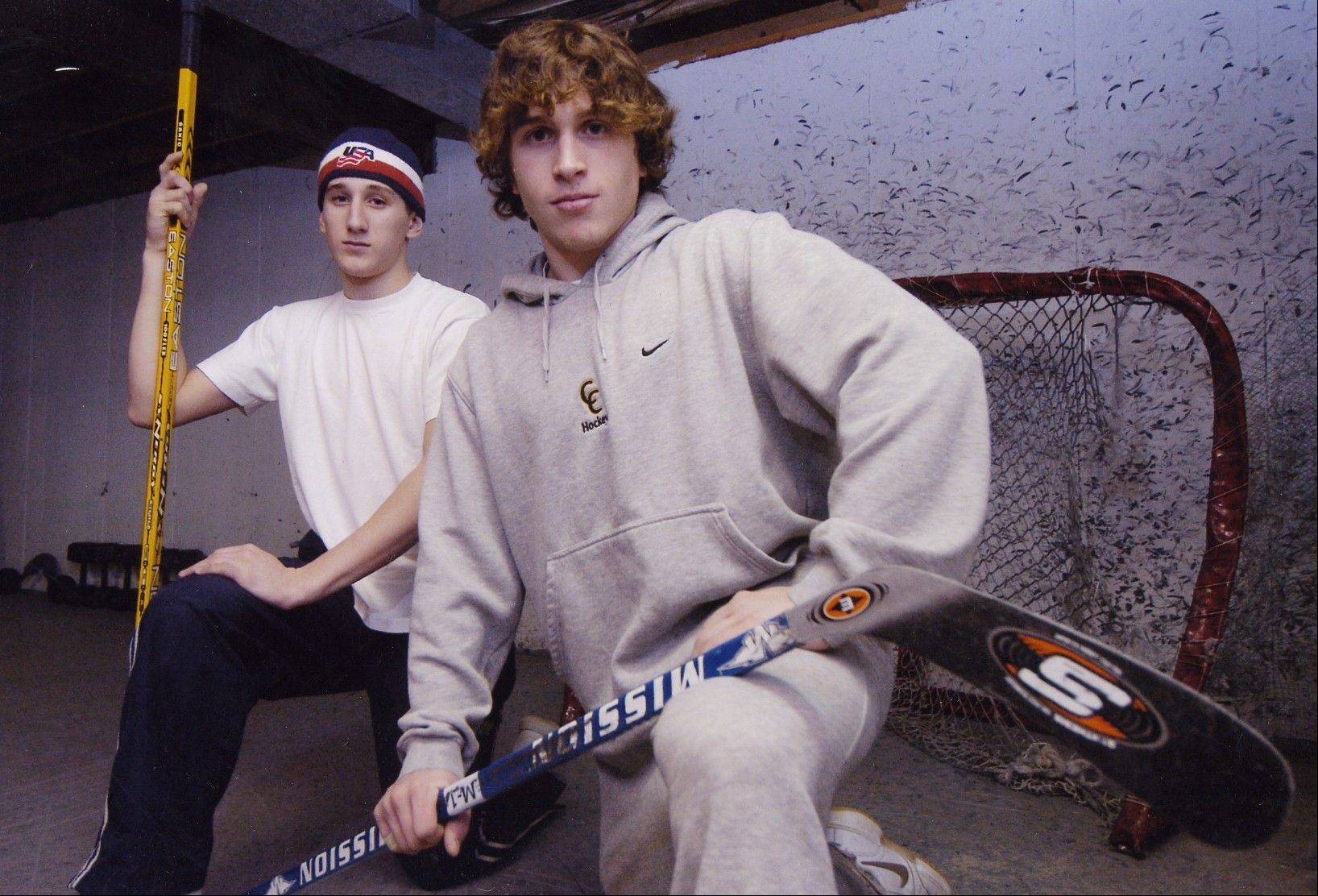 Billy Sweatt, background, and his older brother Lee spent a lot of time taking slap shots in the family basement when they weren't practicing at local arenas. Lee played professional hockey in Europe and briefly with the Vancouver Canucks before retiring last summer, while Lee was called up by the Canucks for a brief stay in December.