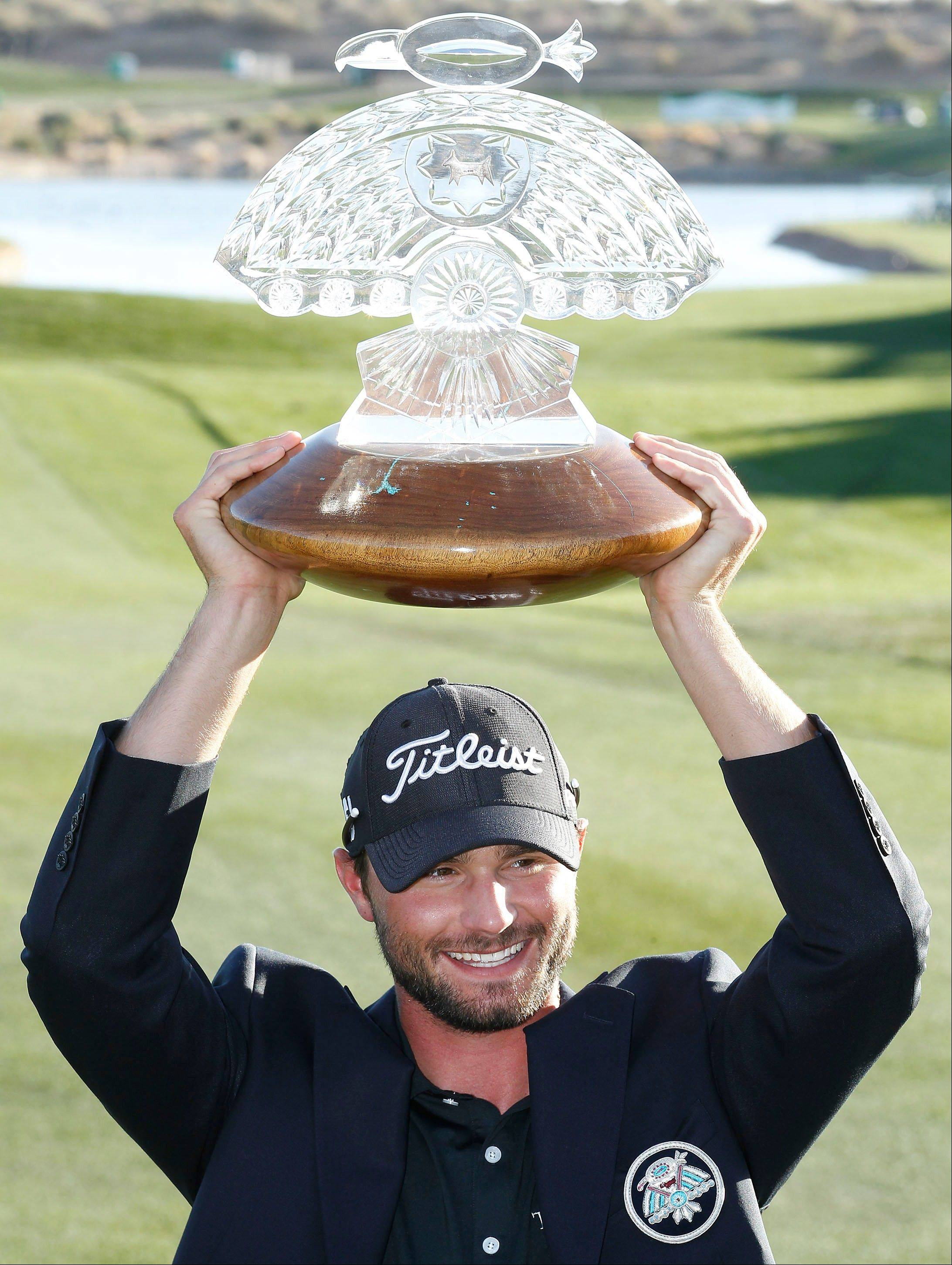 Kyle Stanley holds the championship trophy after winning the Phoenix Open golf tournament Sunday, Feb. 5, 2012, in Scottsdale, Ariz.