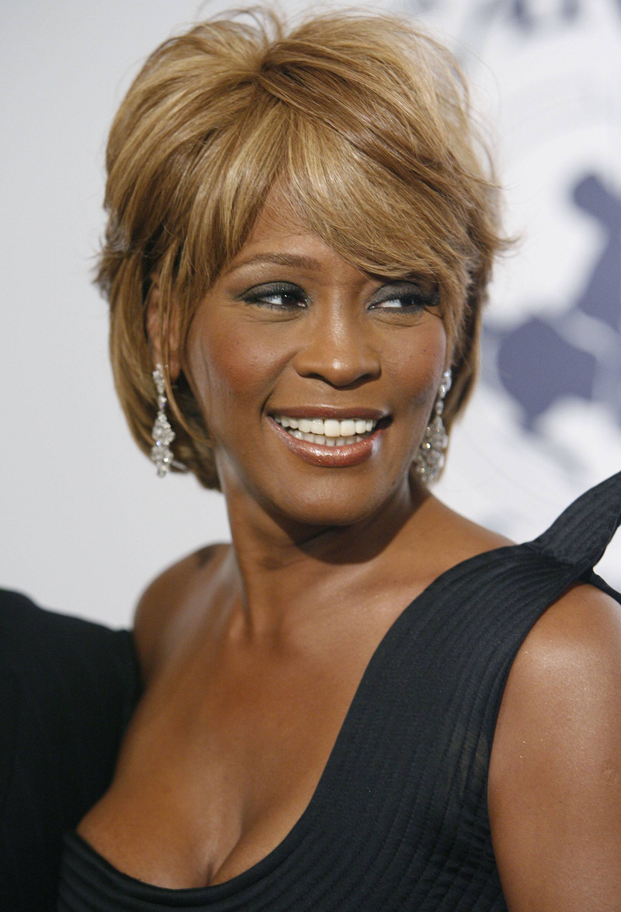 On Oct. 28, 2006, musician Whitney Houston arrives at the 17th Carousel of Hope Ball benefiting the Barbara Davis Center for Childhood Diabetes in Beverly Hills, Calif. Houston died Saturday; she was 48