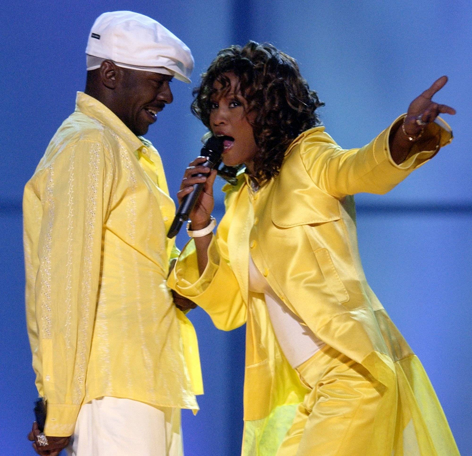 "On May 22, 2003, Whitney Houston, right, and her husband, Bobby Brown, perform during the ""VH1 Divas"" duets show in Las Vegas. Publicist Kristen Foster said Saturday that singer Whitney Houston has died at age 48."