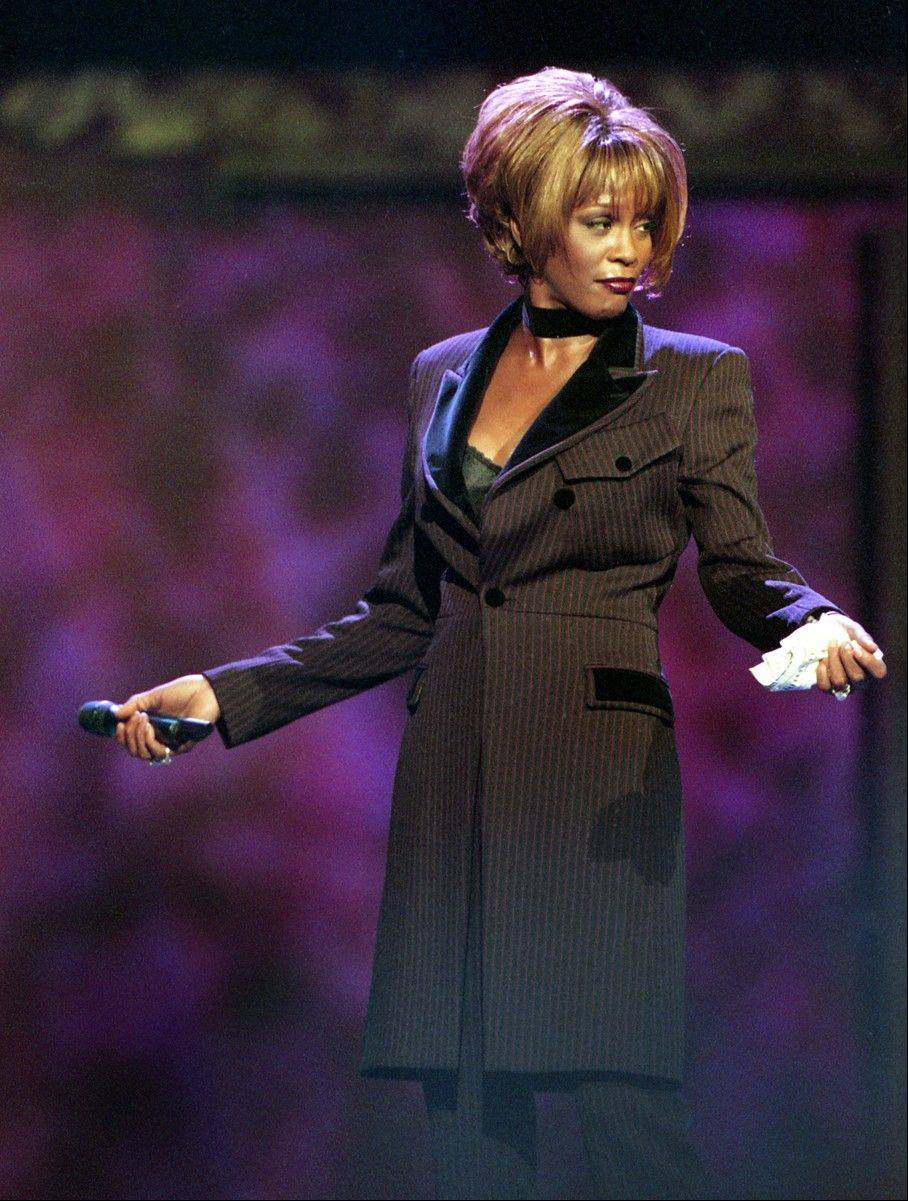 In this photo provided by the Las Vegas News Bureau, Whitney Houston performs during the Billboard Awards at the MGM Grand in Las Vegas on Dec. 7, 1998. Often referred to as the Queen of Pop music at her best, Houston ex-wife of singer Bobby Brown, died Saturday at the age of 48.