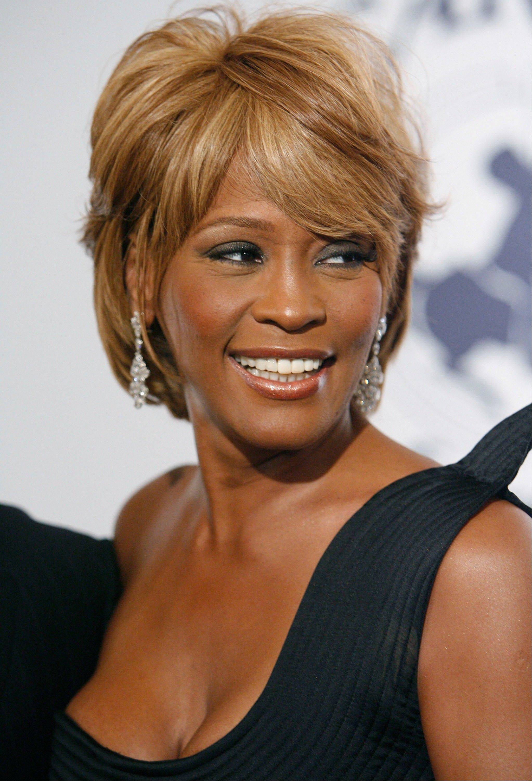 In this Oct. 28, 2006, file photo, musician Whitney Houston arrives at the 17th Carousel of Hope Ball benefiting the Barbara Davis Center for Childhood Diabetes in Beverly Hills, Calif. Houston died Saturday. Houston, who reigned as pop music's queen until her majestic voice and regal image were ravaged by drug use, was 48.