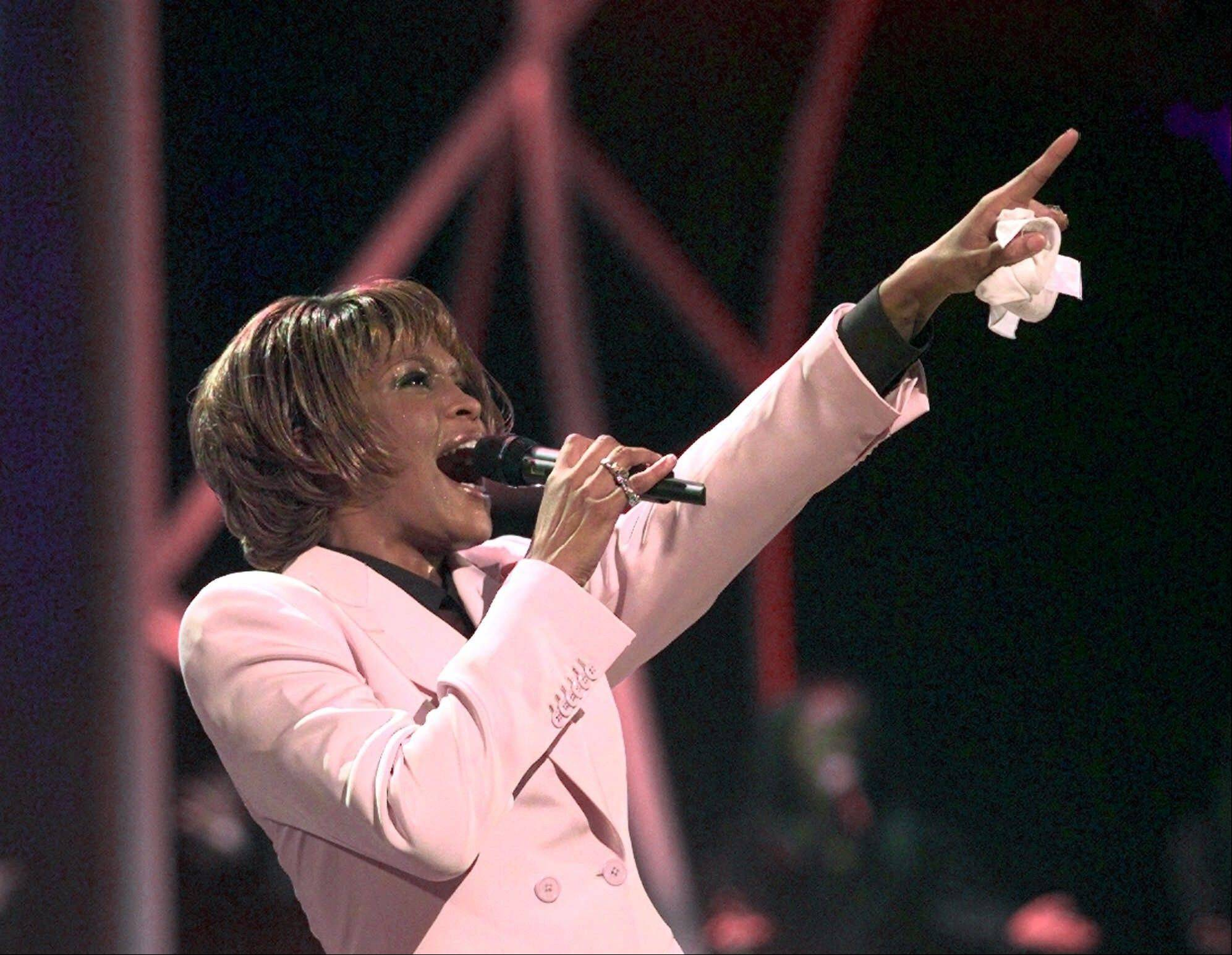 "In this July 11, 1999, file photo, singer Whitney Houston performs ""Until You Come Back To Me"" during the 26th annual American Music Awards at the Shrine Auditorium in Los Angeles."