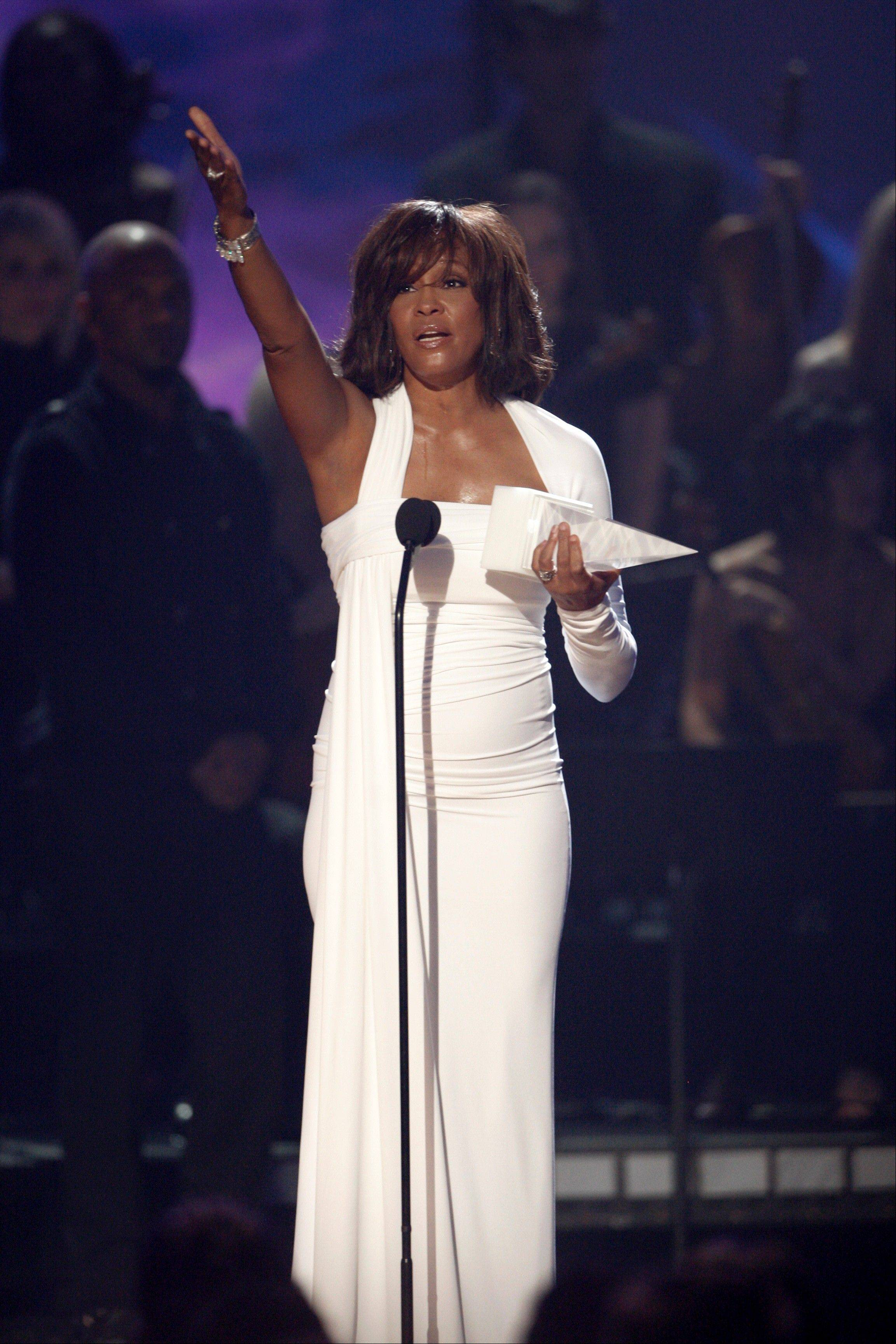 In this Nov. 22, 2009, file photo, artist Whitney Houston receives the International Artist Award onstage at the 37th Annual American Music Awards in Los Angeles.