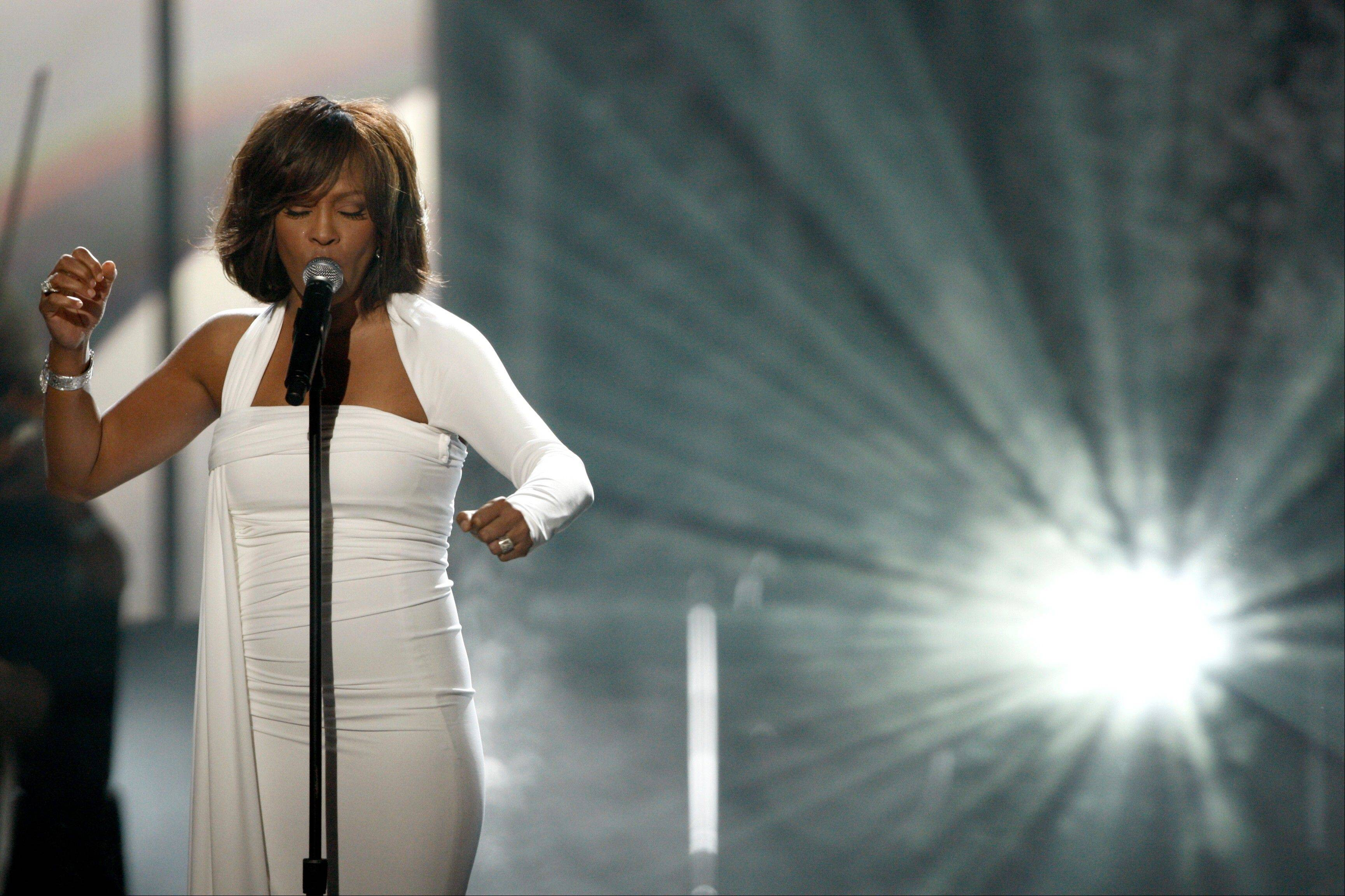 In this Nov. 22, 2009, file photo, Whitney Houston performs at the 37th Annual American Music Awards in Los Angeles.