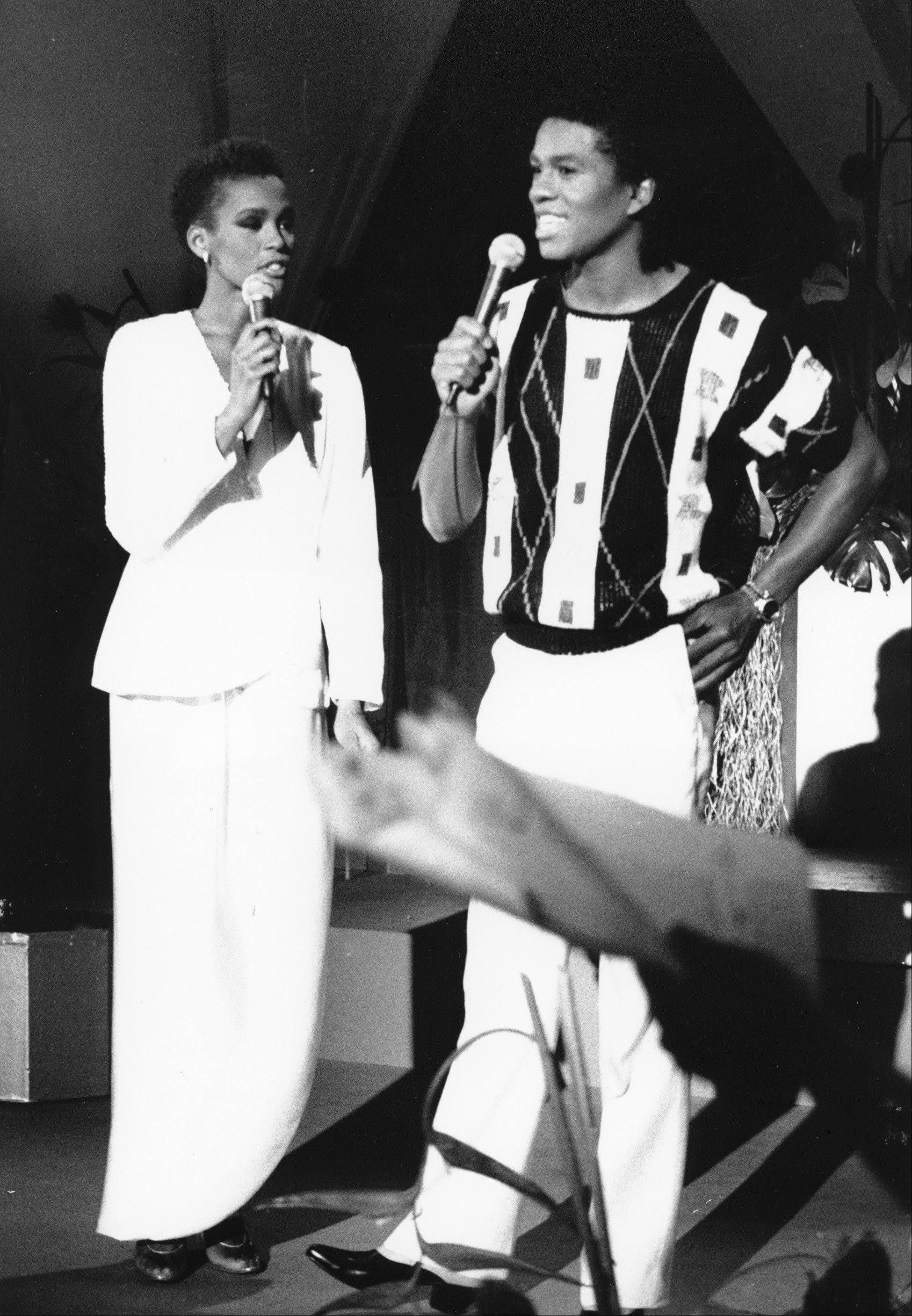 "In this July 25, 1984, file photo, Whitney Houston, left, and Jermaine Jackson sing during a rehearsal for the CBS television soap opera ""As the World Turns"" in New York."