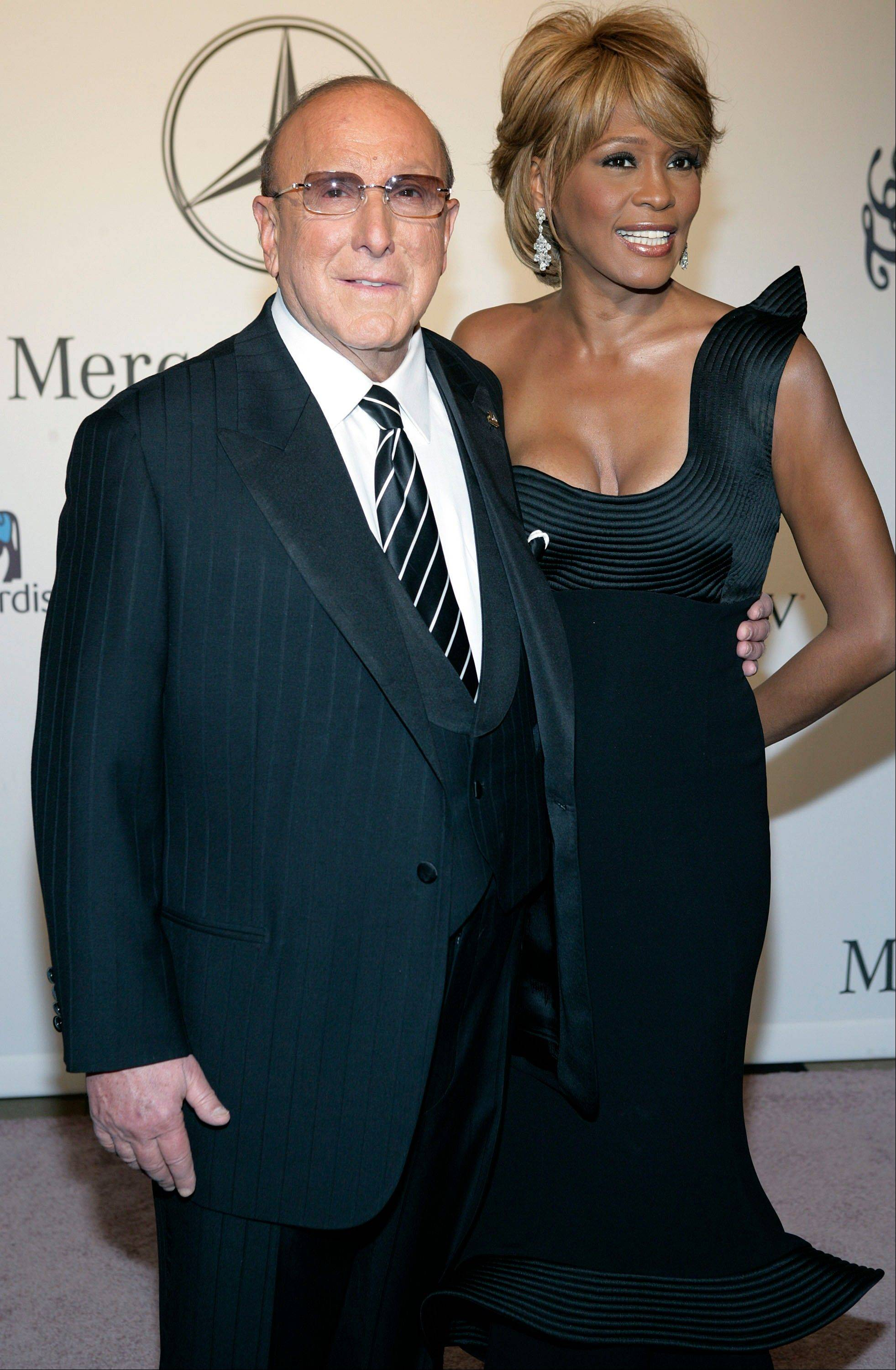 In this Oct. 28, 2006, file photo, Whitney Houston, right, and music producer Clive Davis arrive at the 17th Carousel of Hope Ball benefiting the Barbara Davis Center for Childhood Diabetes in Beverly Hills, Calif.