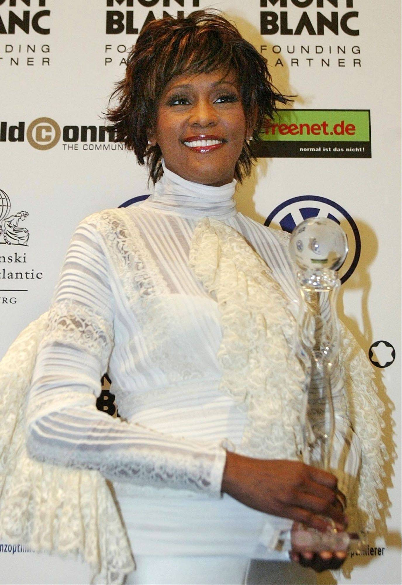 Singer Whitney Houston poses with a lifetime achievement trophy at the World Women's Award ceremony in Hamburg's Congress Center in northern Germany on June 9, 2004.