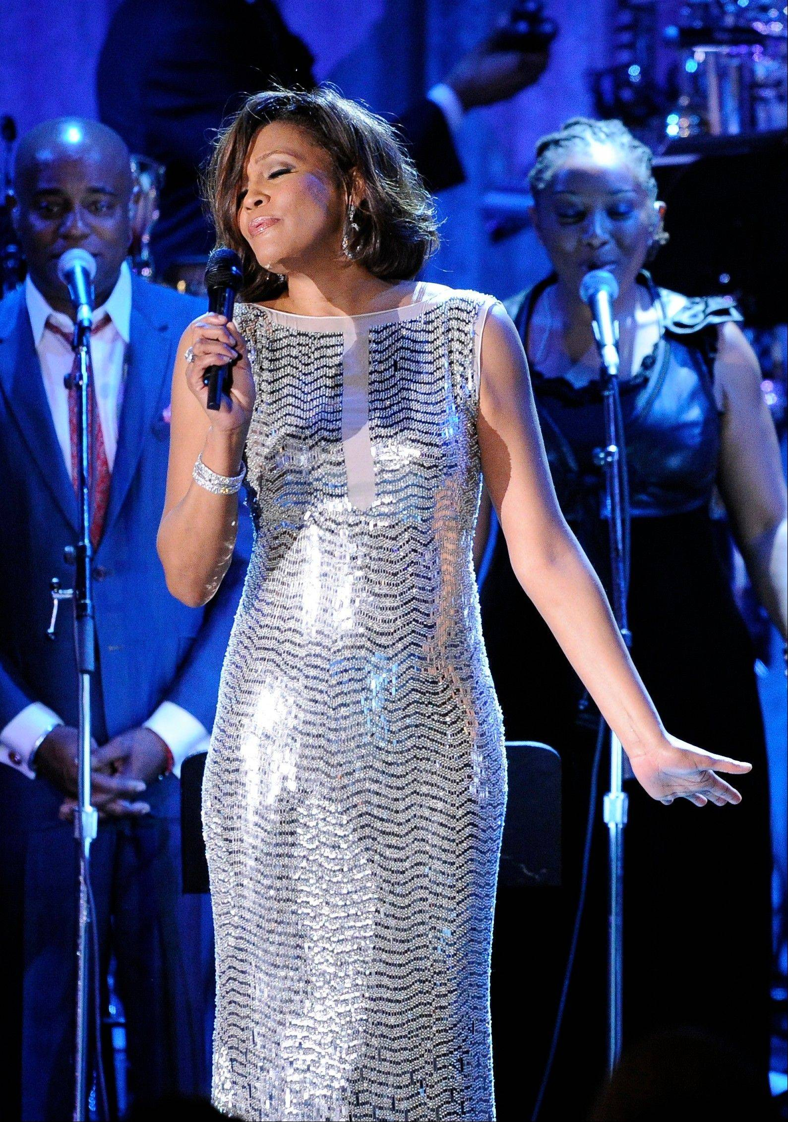 In this Feb. 13, 2011, file photo, singer Whitney Houston performs at the pre-Grammy gala & salute to industry icons with Clive Davis honoring David Geffen in Beverly Hills, Calif.