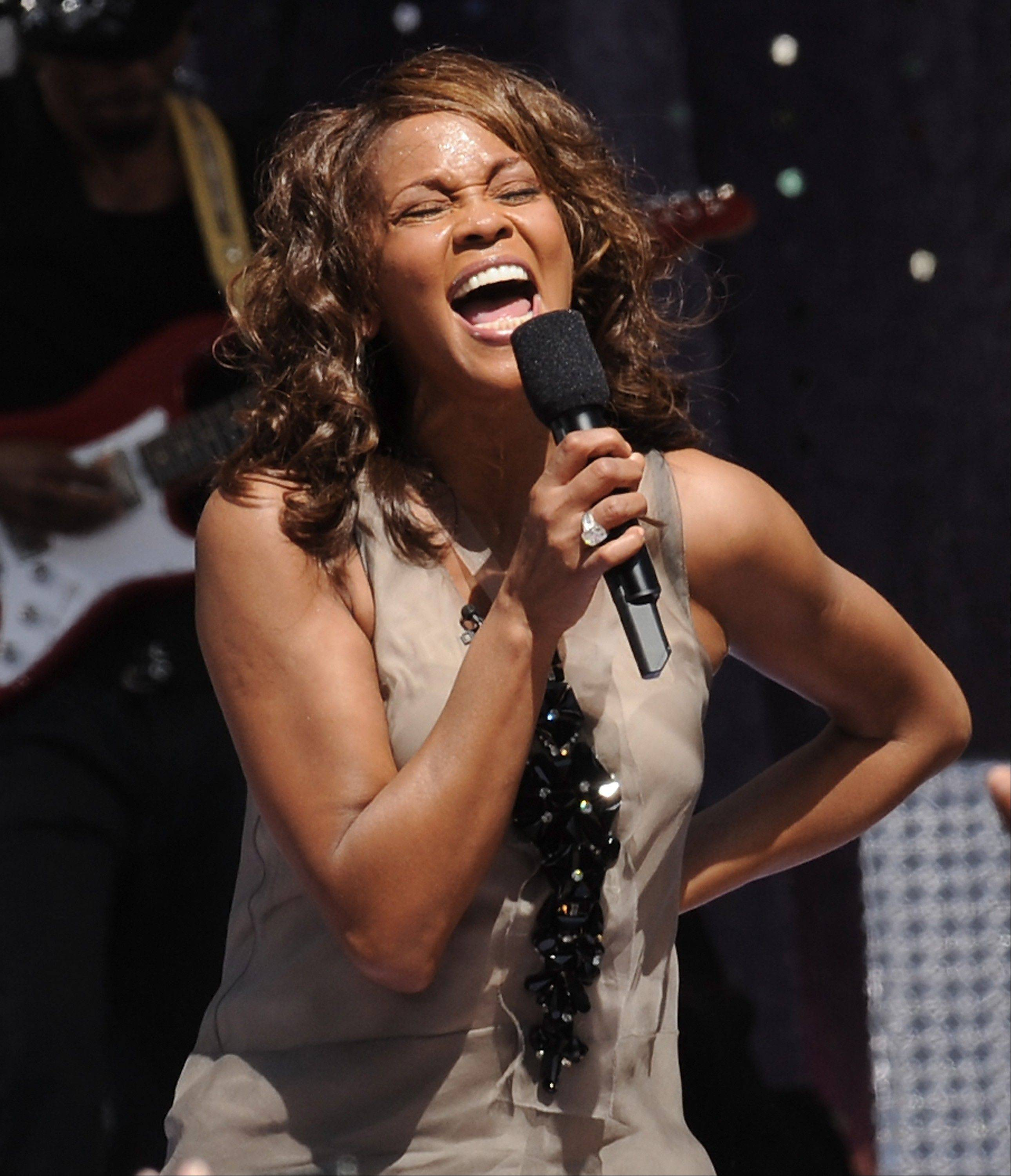 "In this Sept. 1, 2009, file photo, singer Whitney Houston performs on ""Good Morning America"" in New York's Central Park."