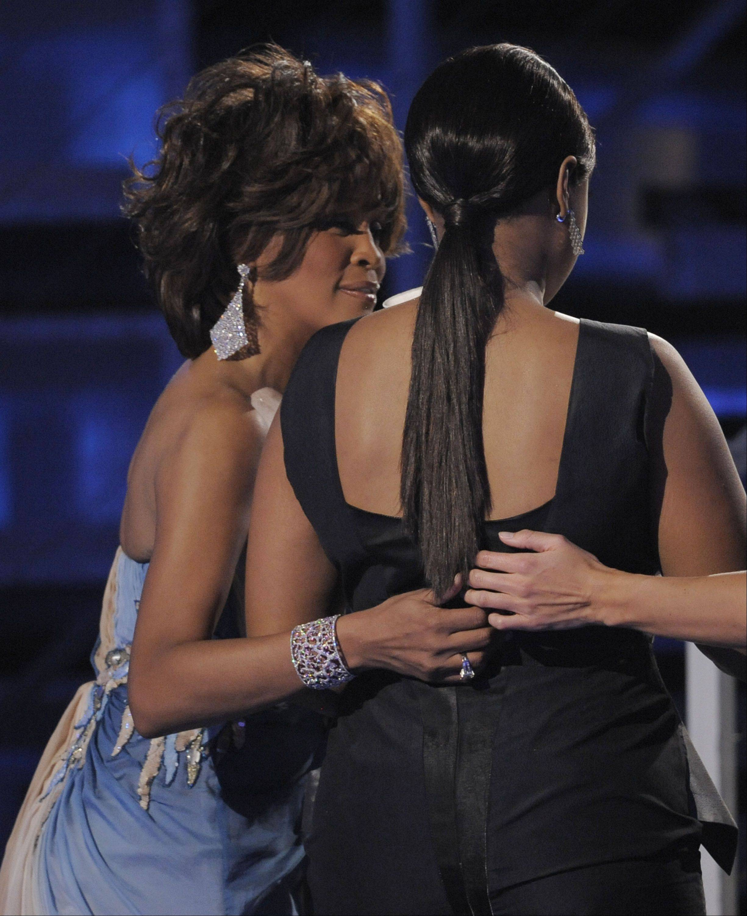 "Whitney Houston, left, leaves the stage with Jennifer Hudson after Hudson accepted the award for best R&B album for ""Jennifer Hudson"" at the 51st Annual Grammy Awards in 2009."