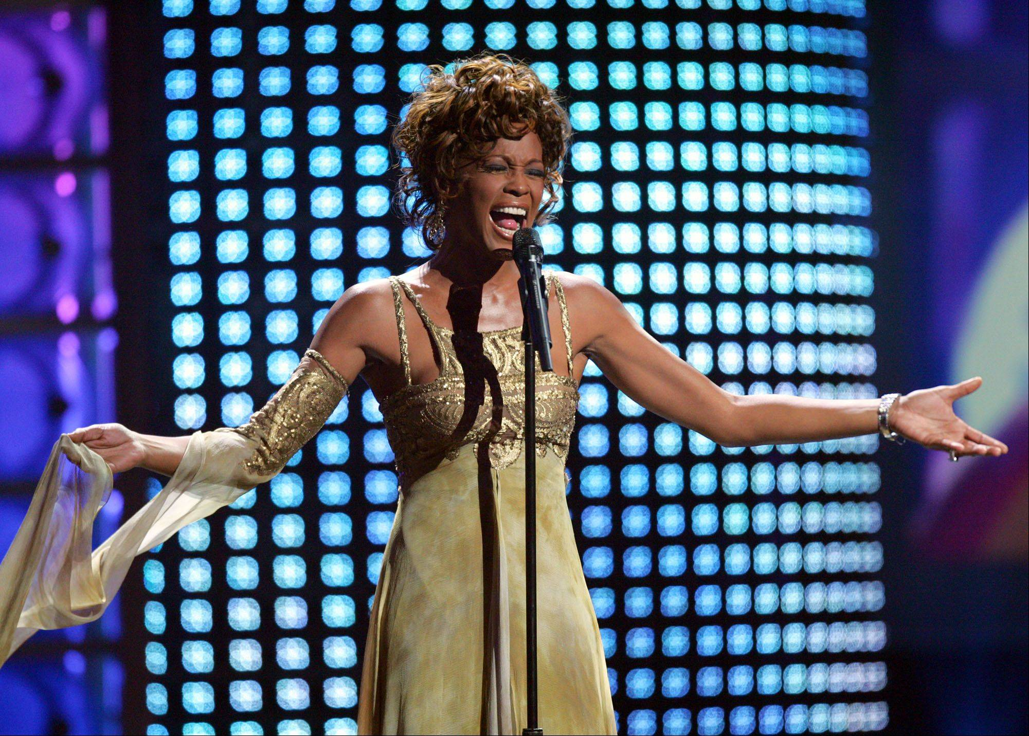 Whitney Houston performs at the 2004 World Music Awards in this Sept. 15, 2004, file photo, at the Thomas and Mack Arena in Las Vegas. A year after her first reported stay in rehab, Whitney Houston checked into a rehabilitation facility in 2005.