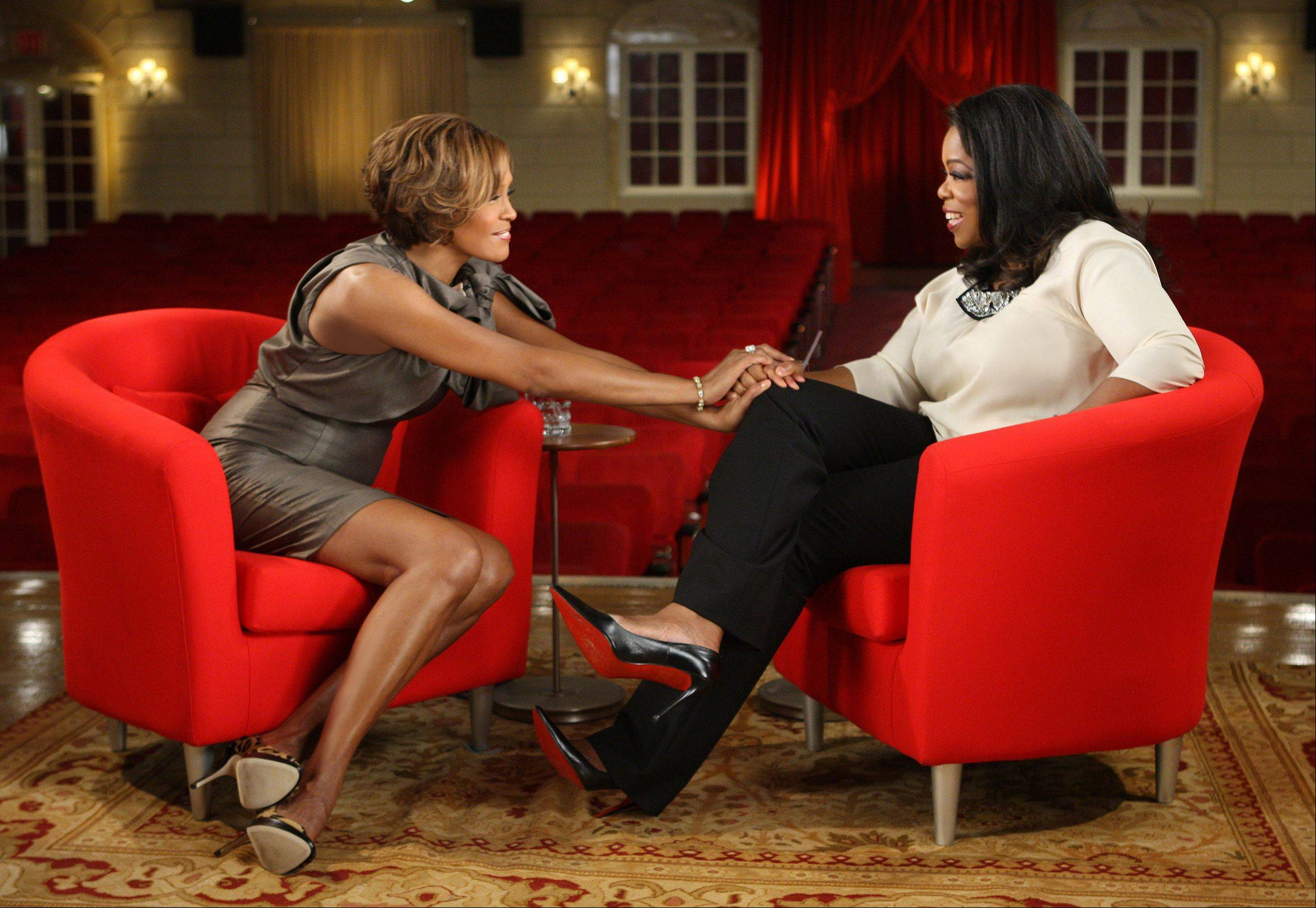 "This Aug. 31, 2009, photo provided by Harpo Productions shows television talk-show host Oprah Winfrey, right, and Whitney Houston during an interview at the Town Hall in New York. She told Winfrey, ""When it gets to the point where you're sitting in your home and you're just trying to cover what you don't want people to know, it's painful. And then you want more just so that you don't let anybody see you cry."""