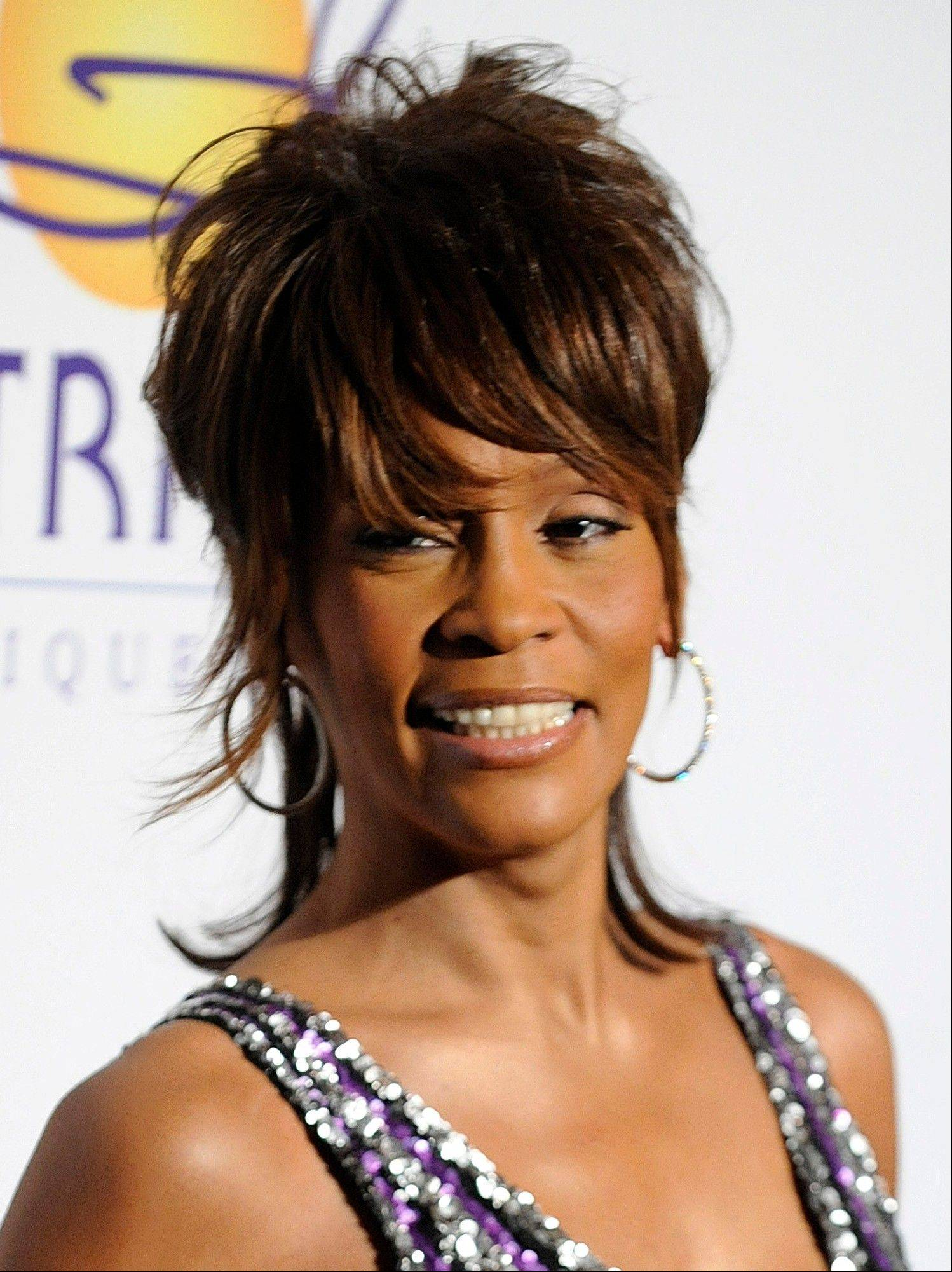 In this Feb. 9, 2008, file photo, singer Whitney Houston arrives at the Clive Davis Pre-Grammy Party in Beverly Hills, Calif.