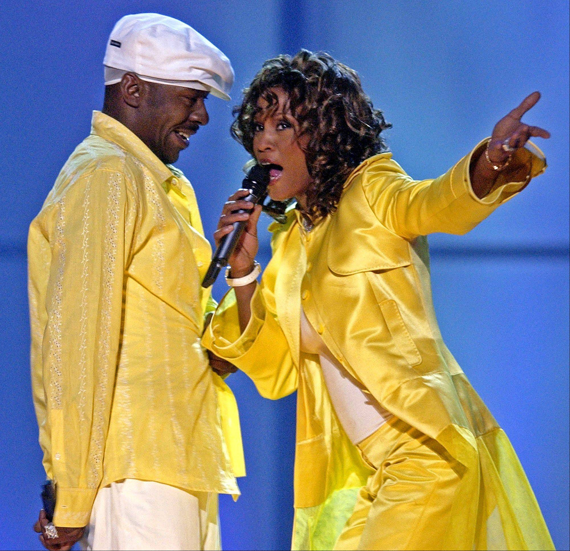 "In this May 23, 2003, file photo, Whitney Houston, right, and her then-husband, Bobby Brown, perform during the ""VH1 Divas"" duets show in Las Vegas."
