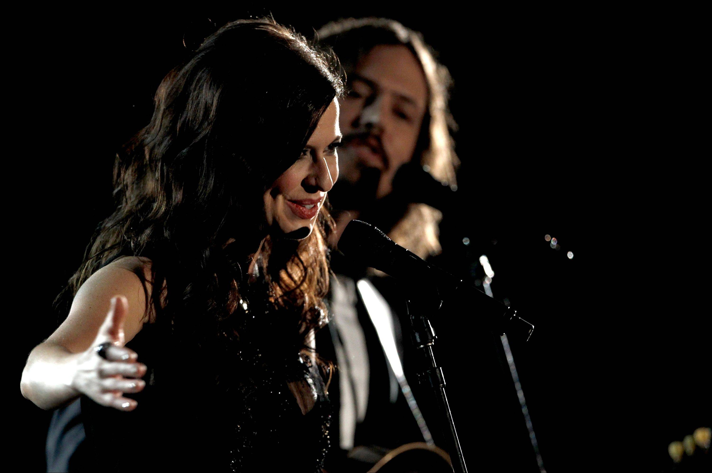 Joy Williams, left, and John Paul White, of musical group The Civil Wars, perform Sunday during the 54th annual Grammy Awards in Los Angeles.