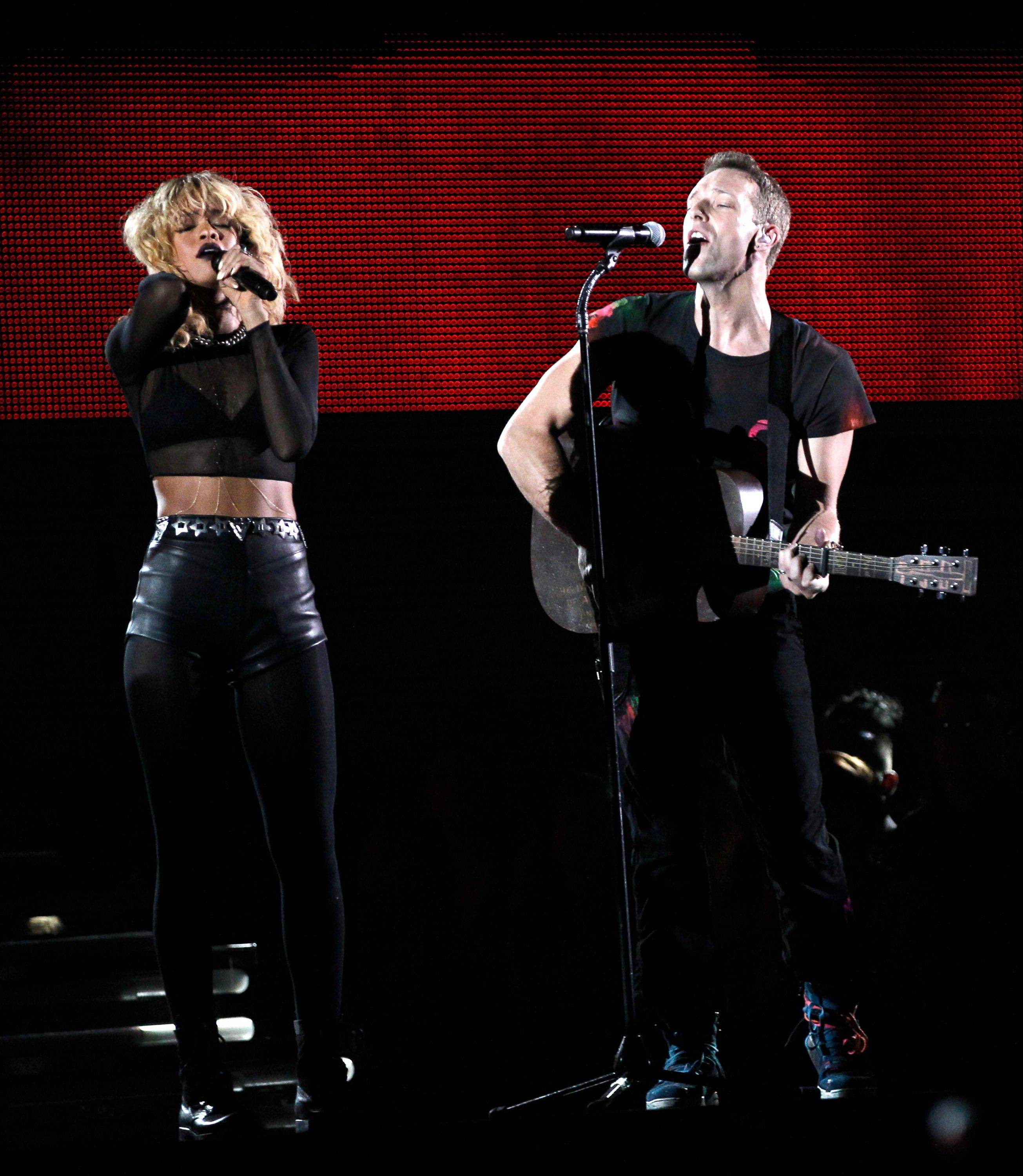 Rihanna, left, and Chris Martin of the band Coldplay perform Sunday during the 54th annual Grammy Awards in Los Angeles.