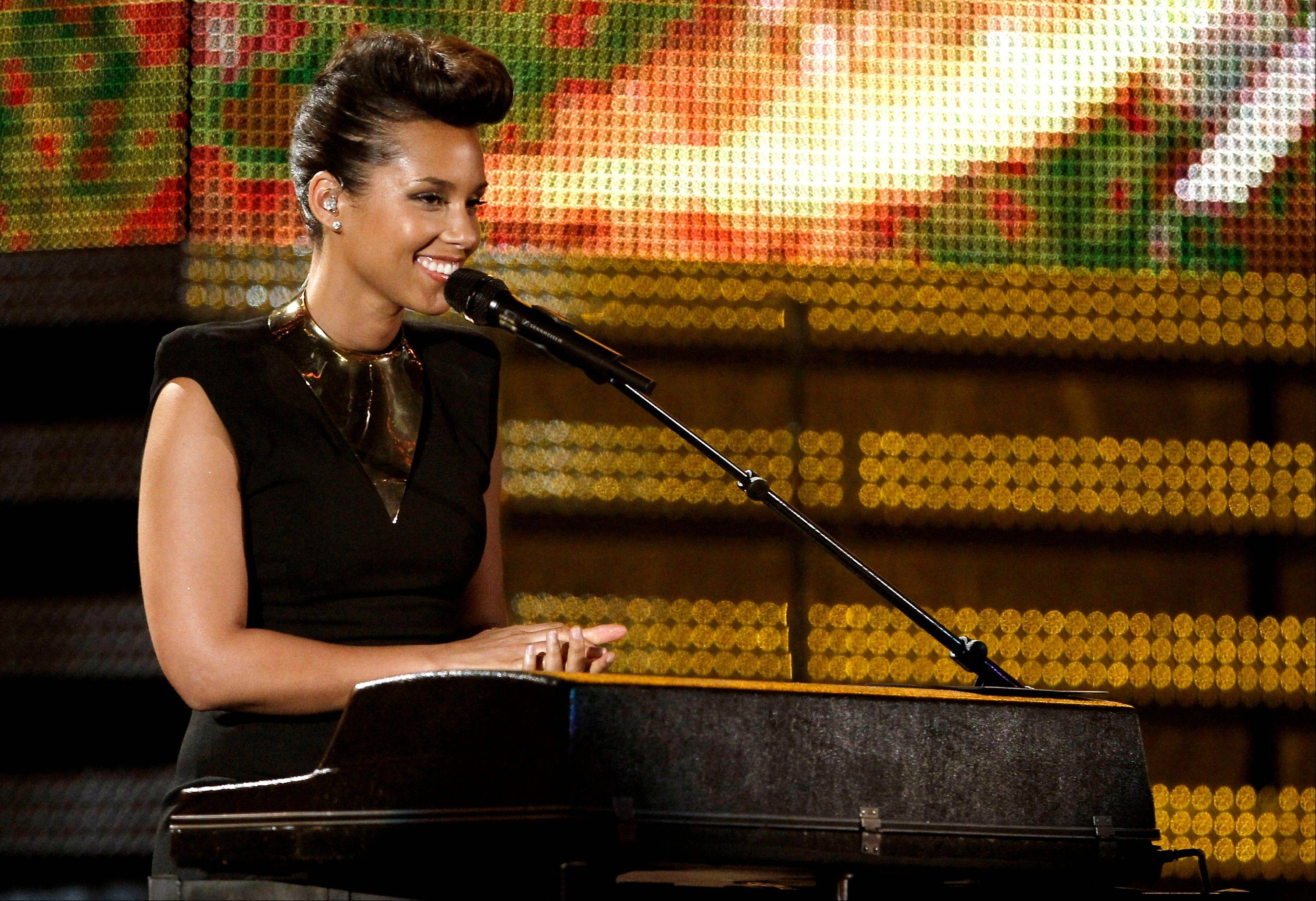 Alicia Keys performs Sunday during the 54th annual Grammy Awards in Los Angeles.