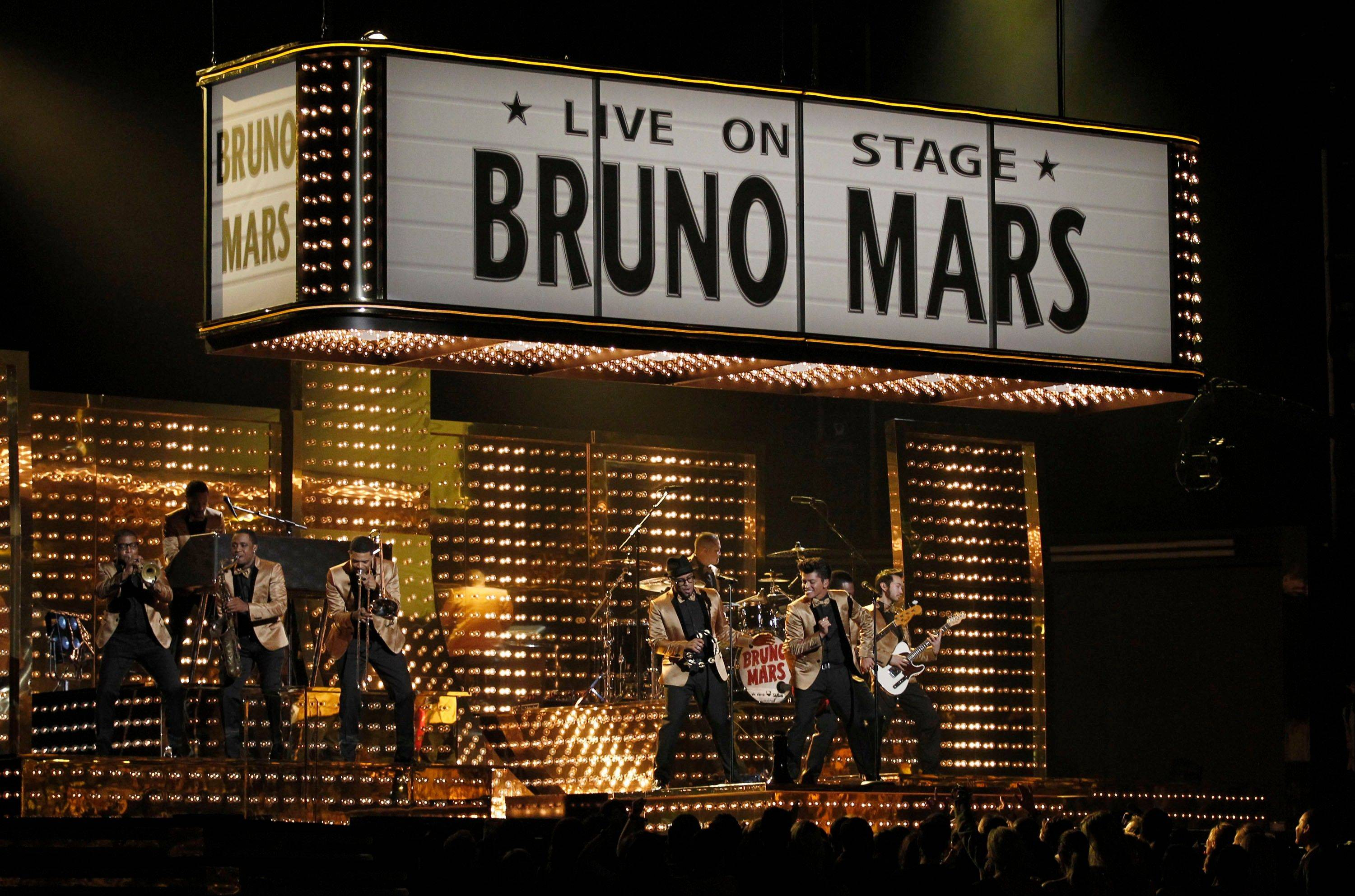 Bruno Mars performs Sunday at the 54th annual Grammy Awards in Los Angeles.