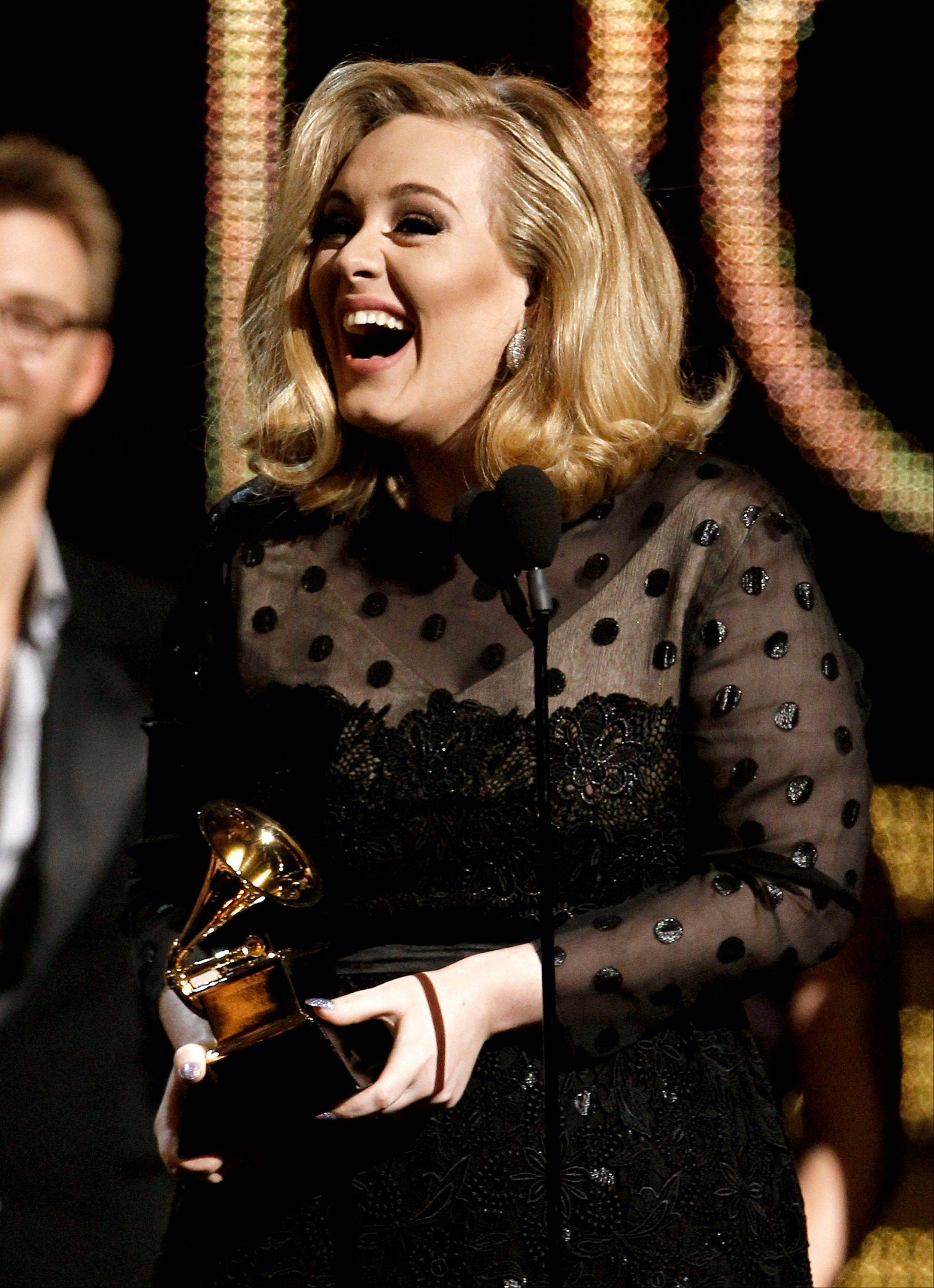 "Adele accepts the award for record of the year for ""Rolling in the Deep"" during the 54th annual Grammy Awards on Sunday in Los Angeles."