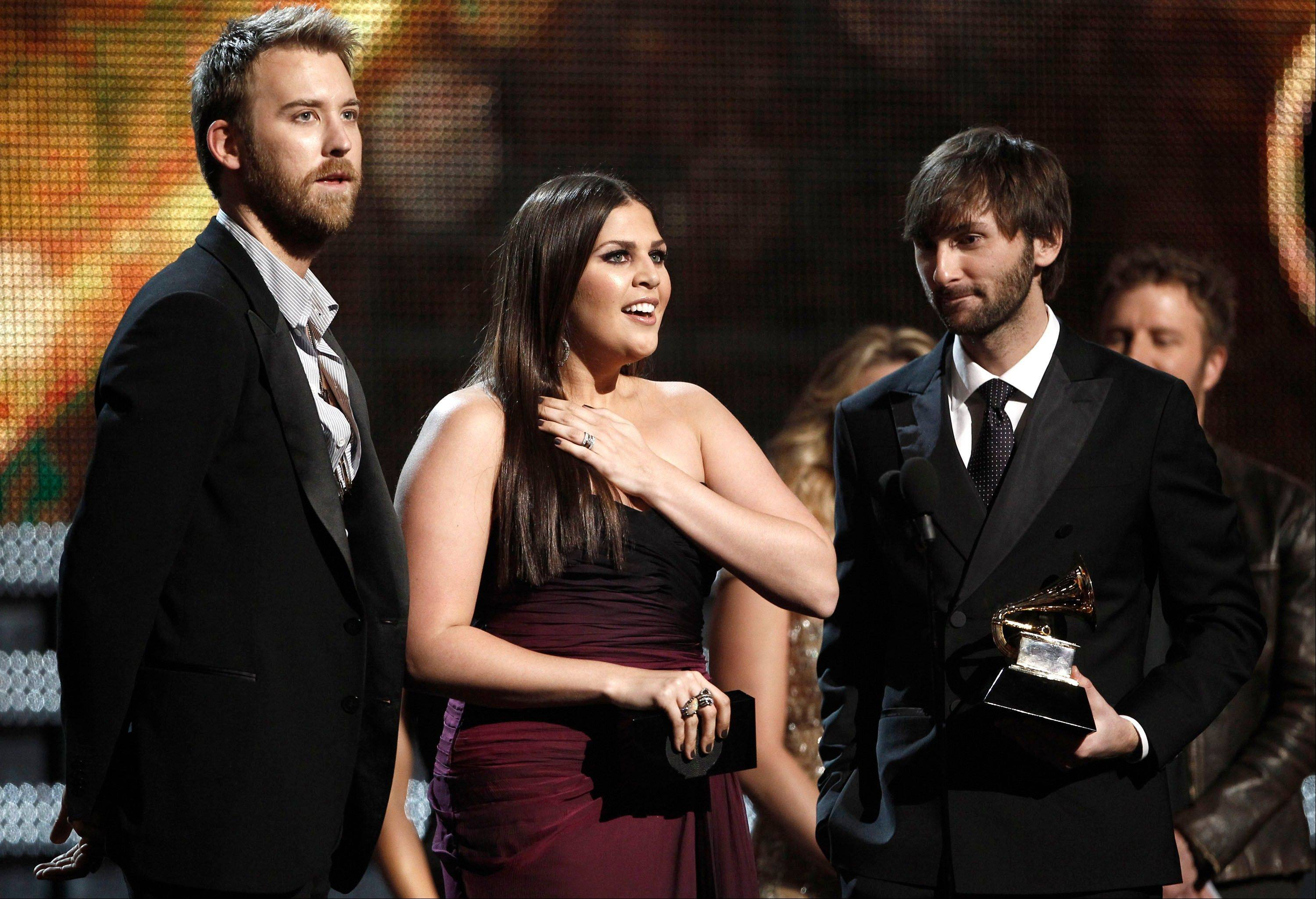 "The band Lady Antebellum -- from left, Charles Kelley, Hillary Scott and Dave Haywood -- accepts the award for best country album for ""Own the Night"" during the 54th annual Grammy Awards on Sunday in Los Angeles."