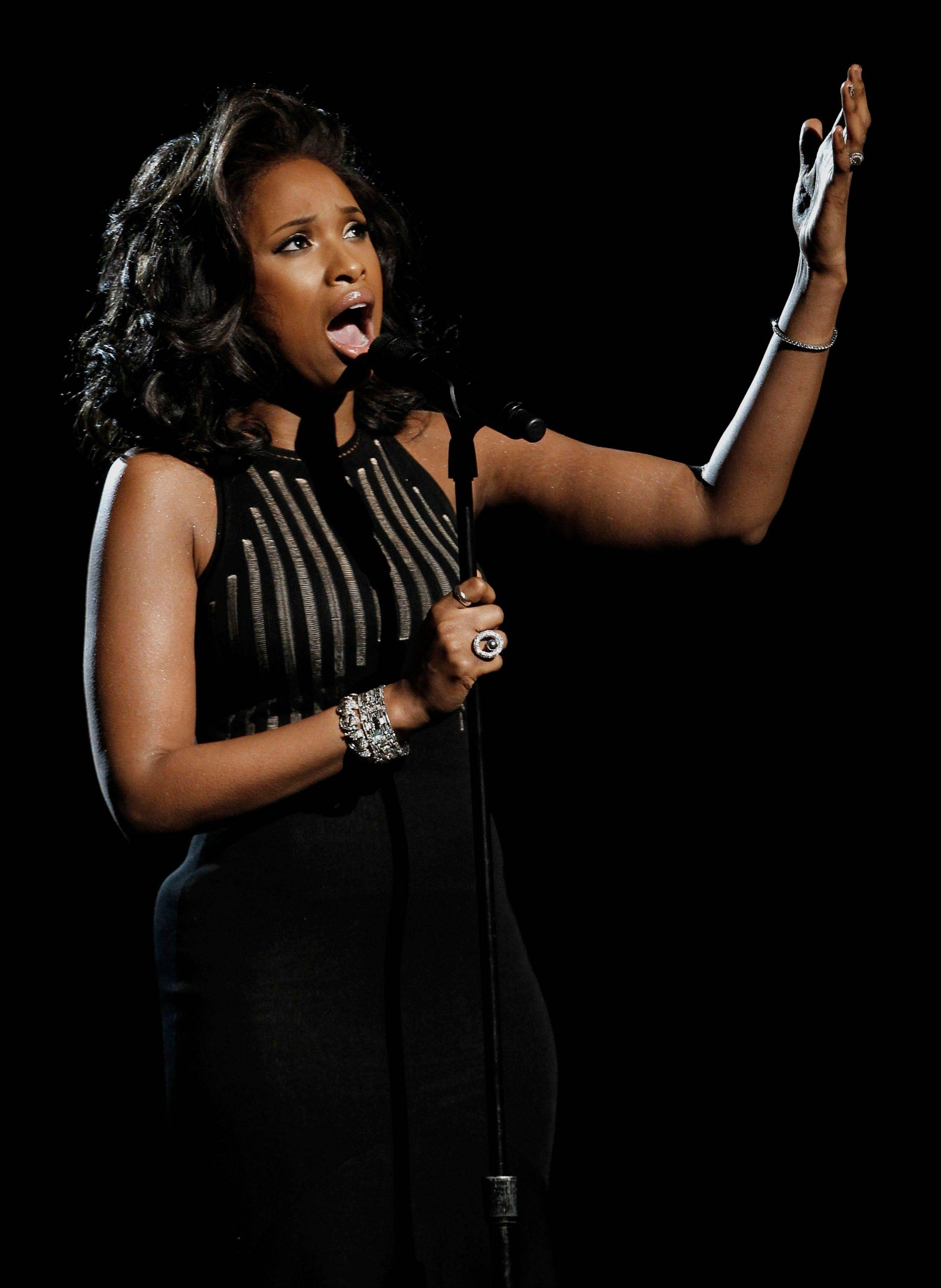 "Jennifer Hudson performs ""I Will Always Love You"" during the In Memoriam portion of the 54th annual Grammy Awards on Sunday in Los Angeles."