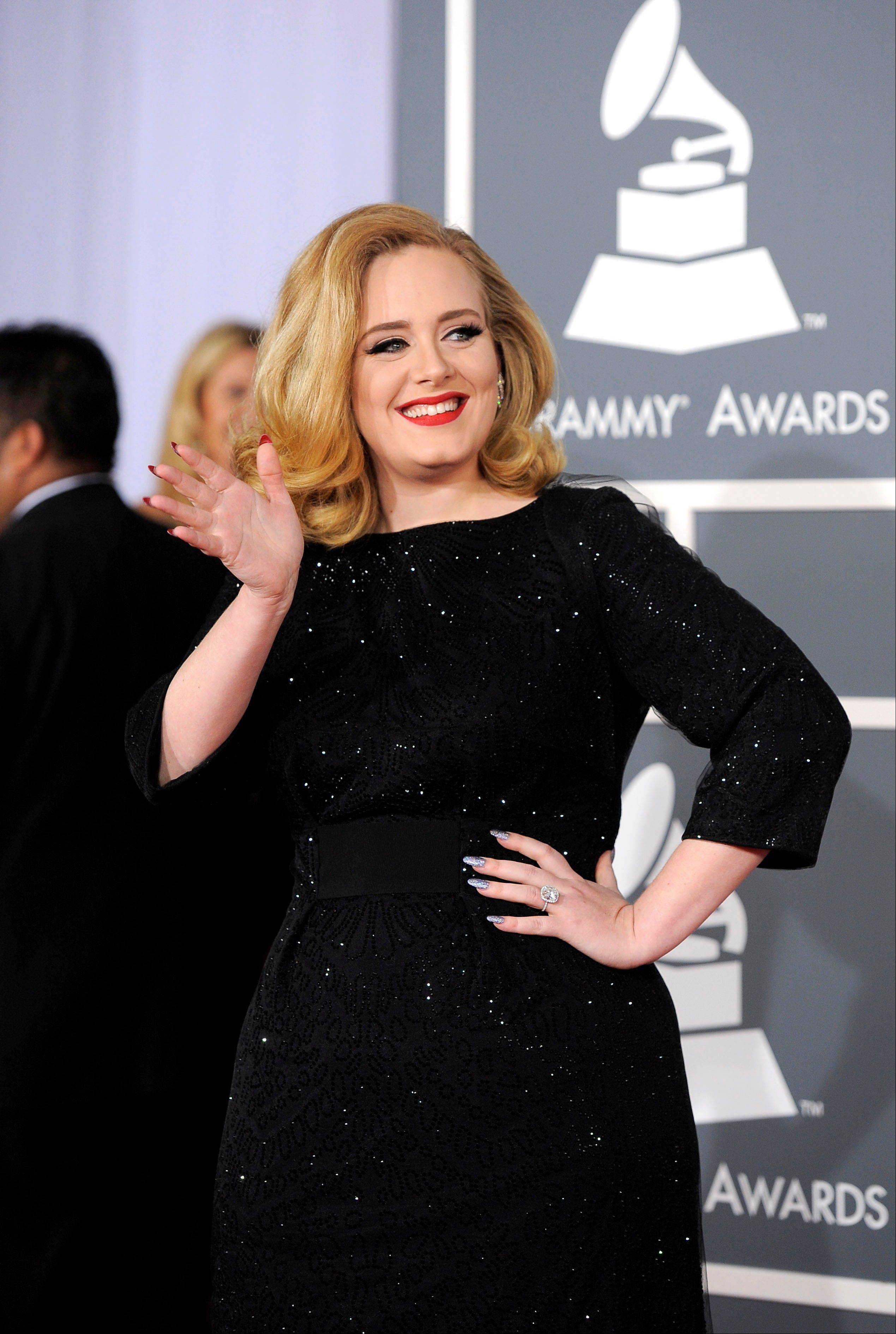 Adele arrives Sunday at the 54th annual Grammy Awards in Los Angeles.