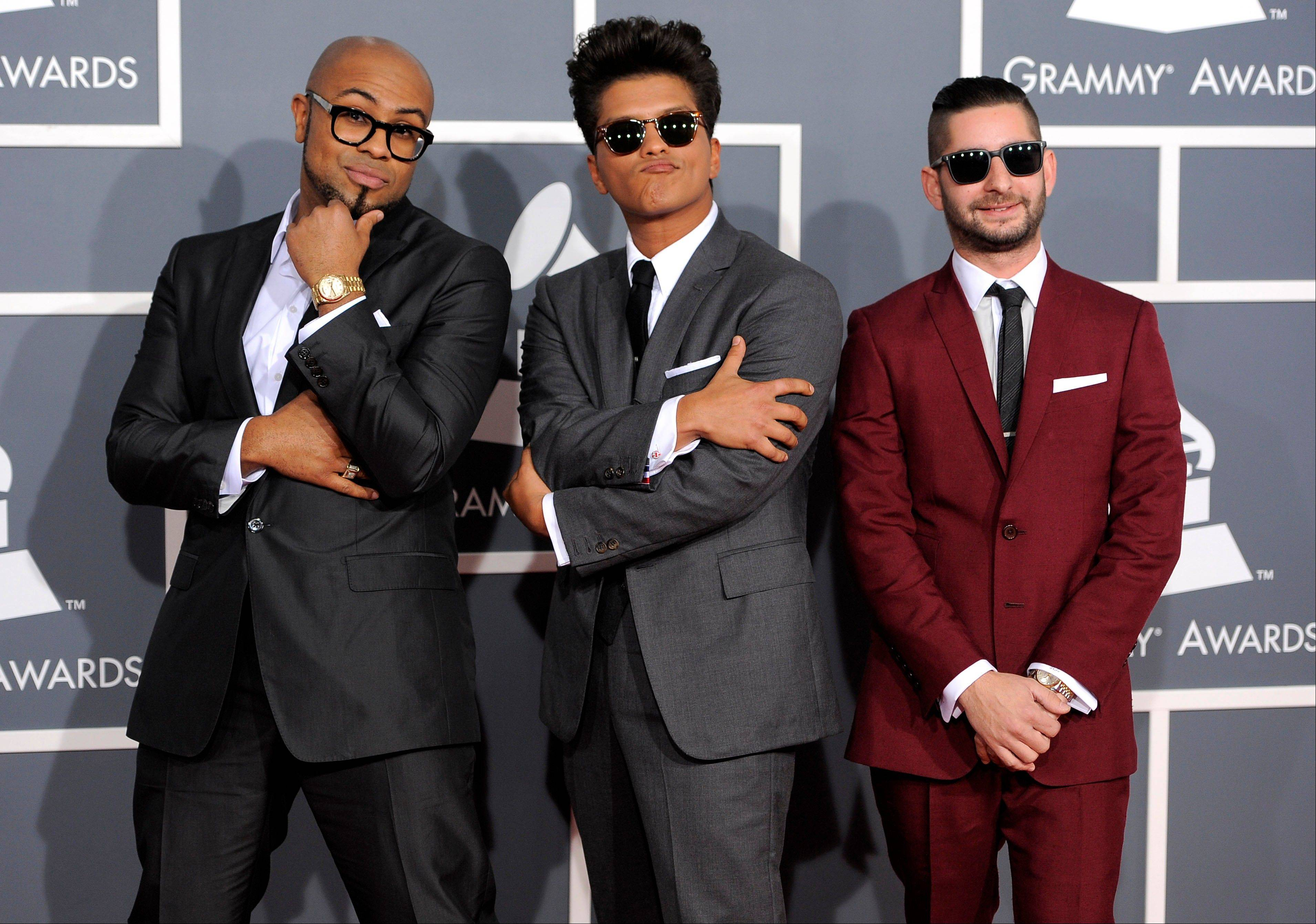Bruno Mars, center, and The Smeezingtons arrive Sunday at the 54th annual Grammy Awards in Los Angeles.