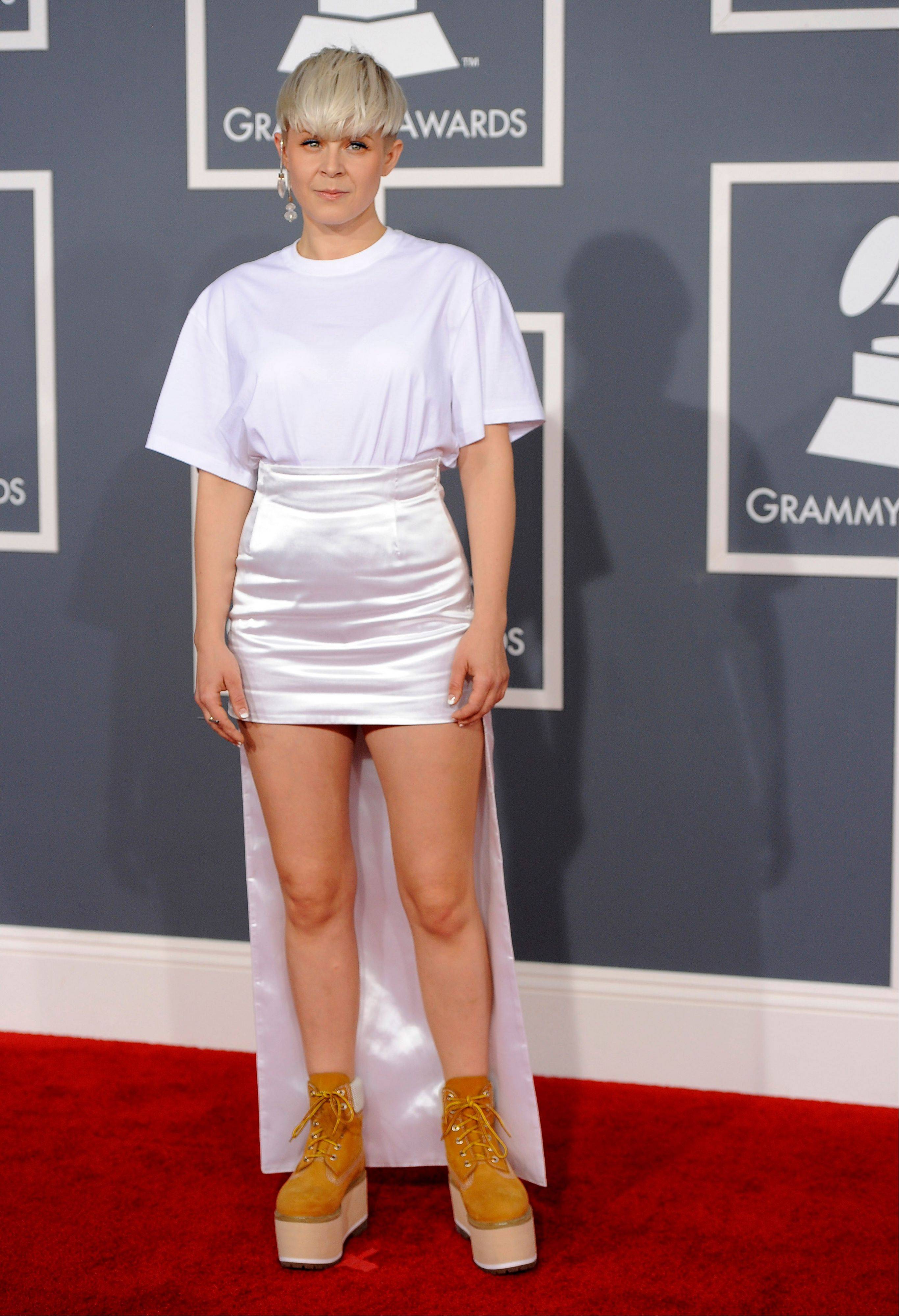Robyn arrives Sunday at the 54th annual Grammy Awards in Los Angeles.