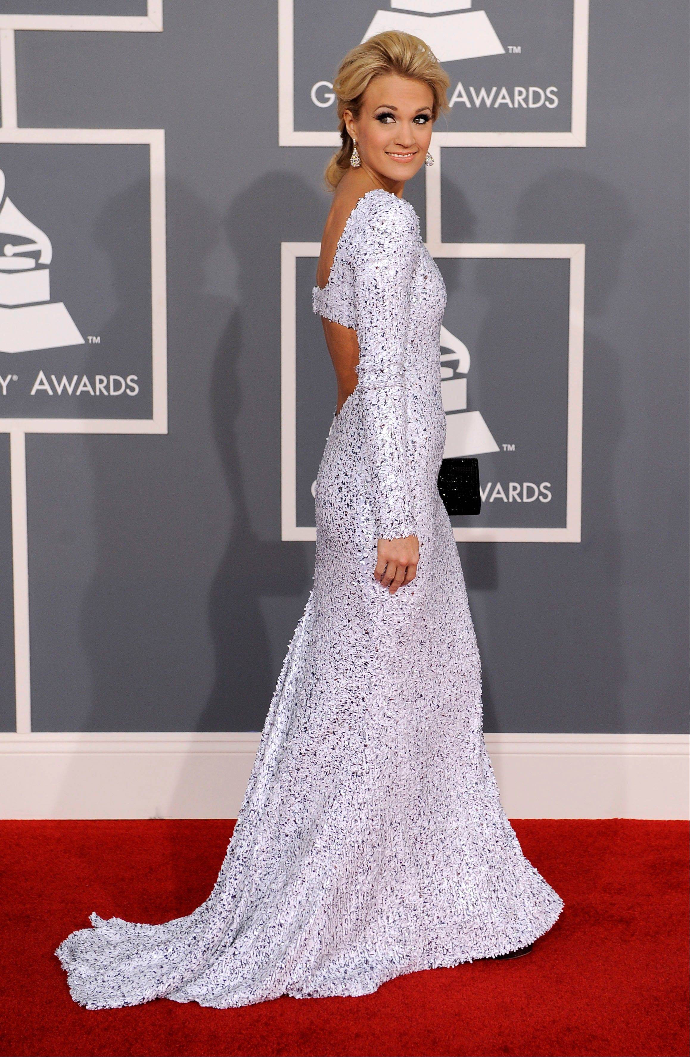 Carrie Underwood arrives Sunday at the 54th annual Grammy Awards in Los Angeles.