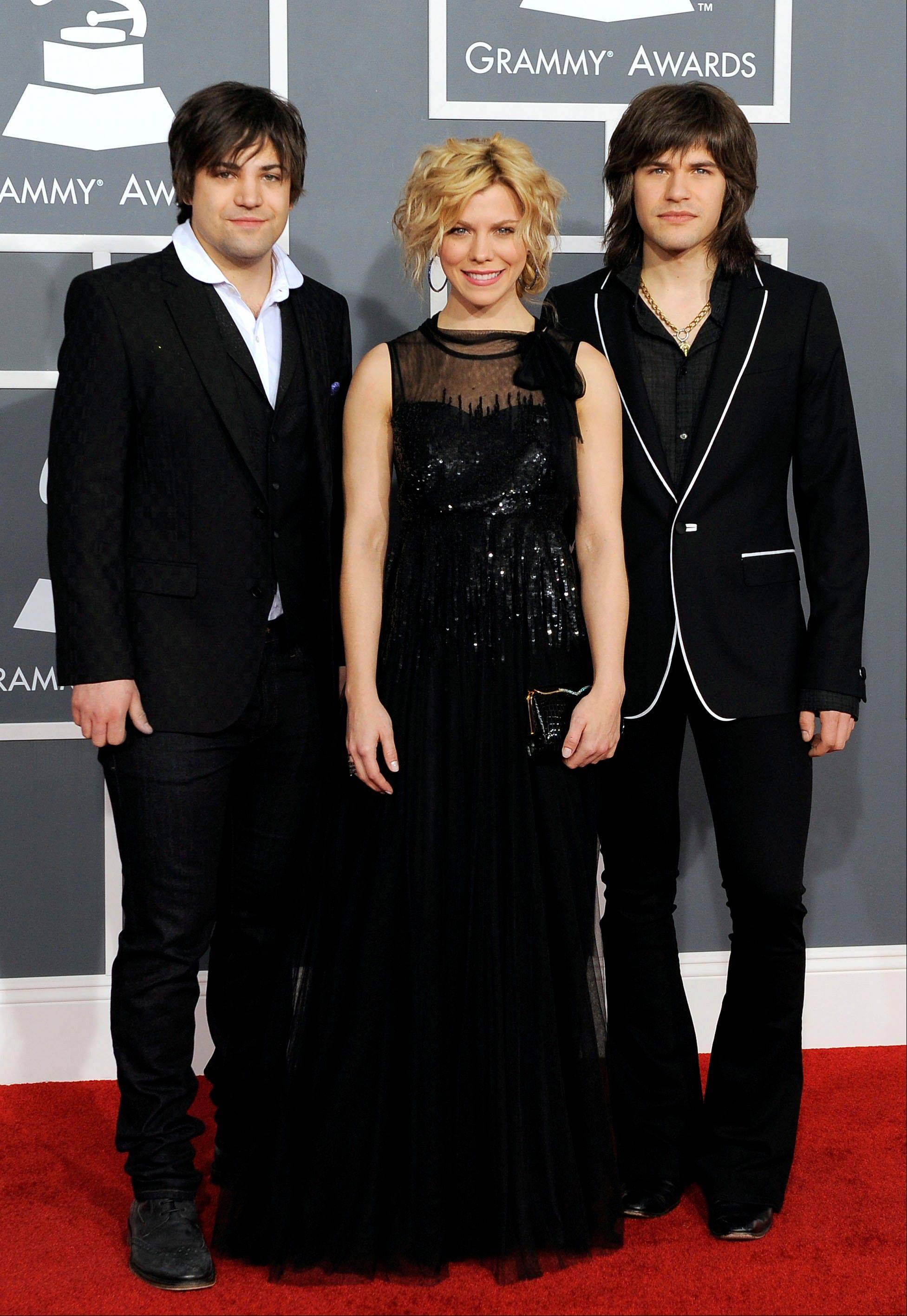 Neil, left, Kimberly and Reid Perry of The Band Perry arrive Sunday at the 54th annual Grammy Awards in Los Angeles.