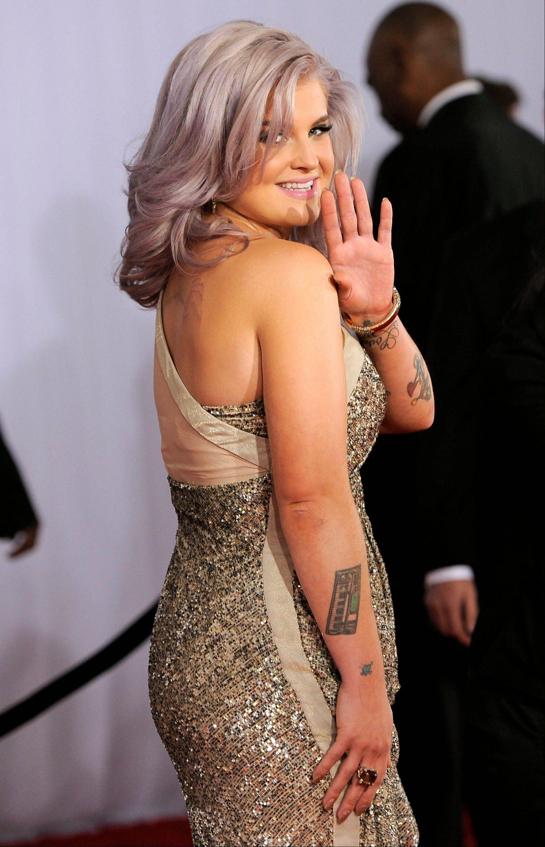Kelly Osbourne arrives Sunday at the 54th annual Grammy Awards in Los Angeles.