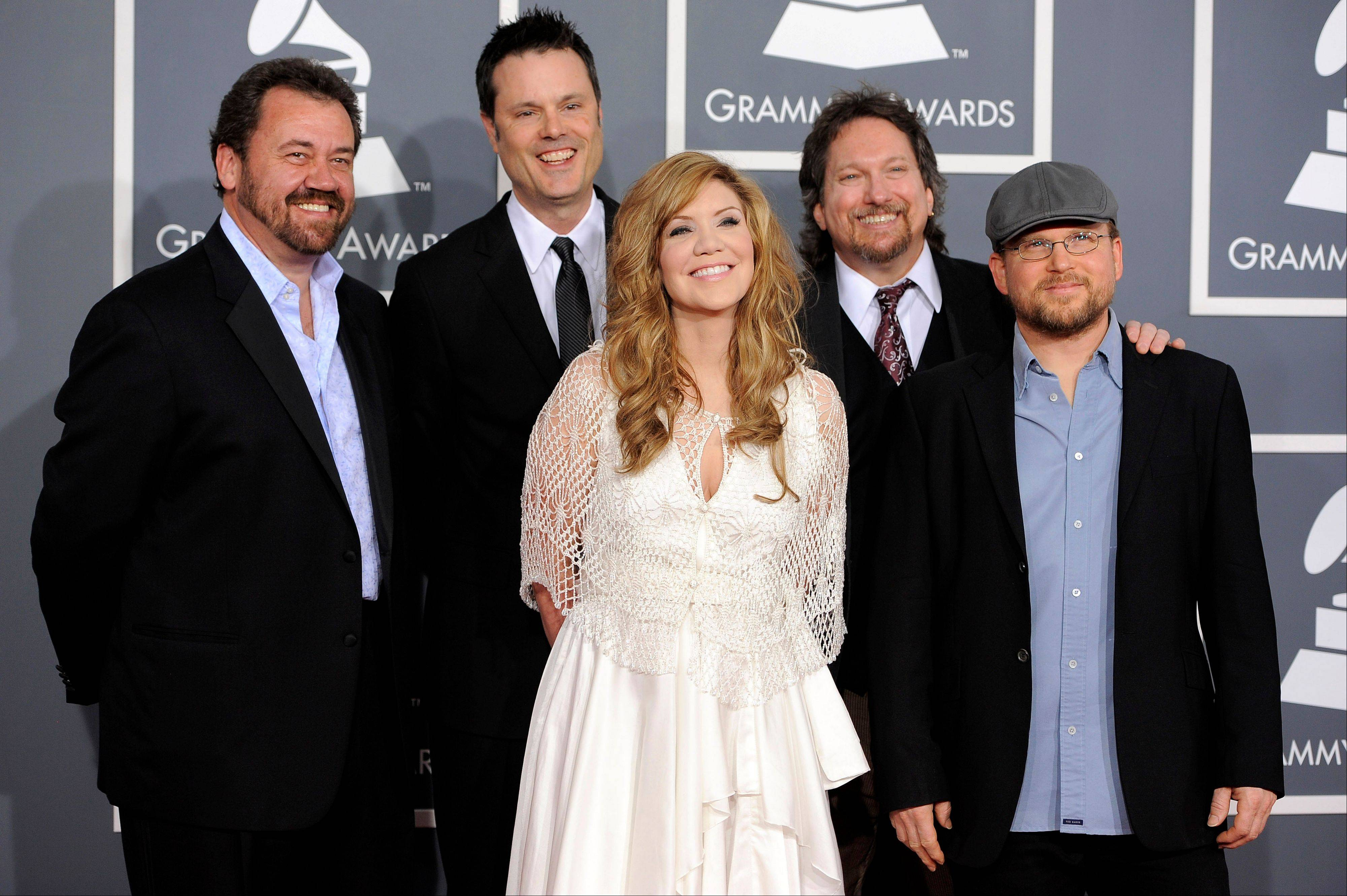 Alison Krauss, center, and the band Union Station arrive Sunday at the 54th annual Grammy Awards in Los Angeles.