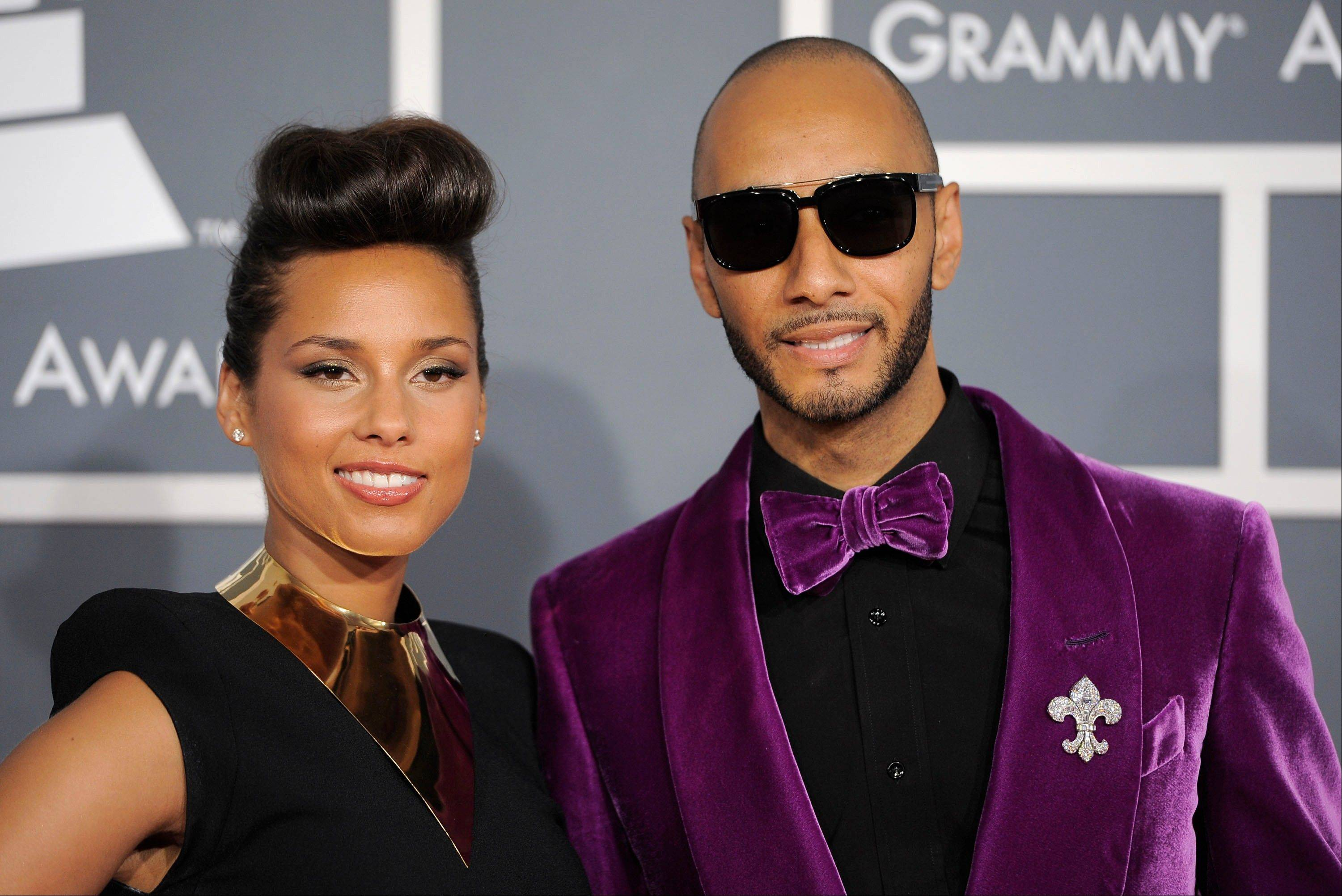Alicia Keys, left, and Swizz Beatz arrive Sunday at the 54th annual Grammy Awards in Los Angeles.
