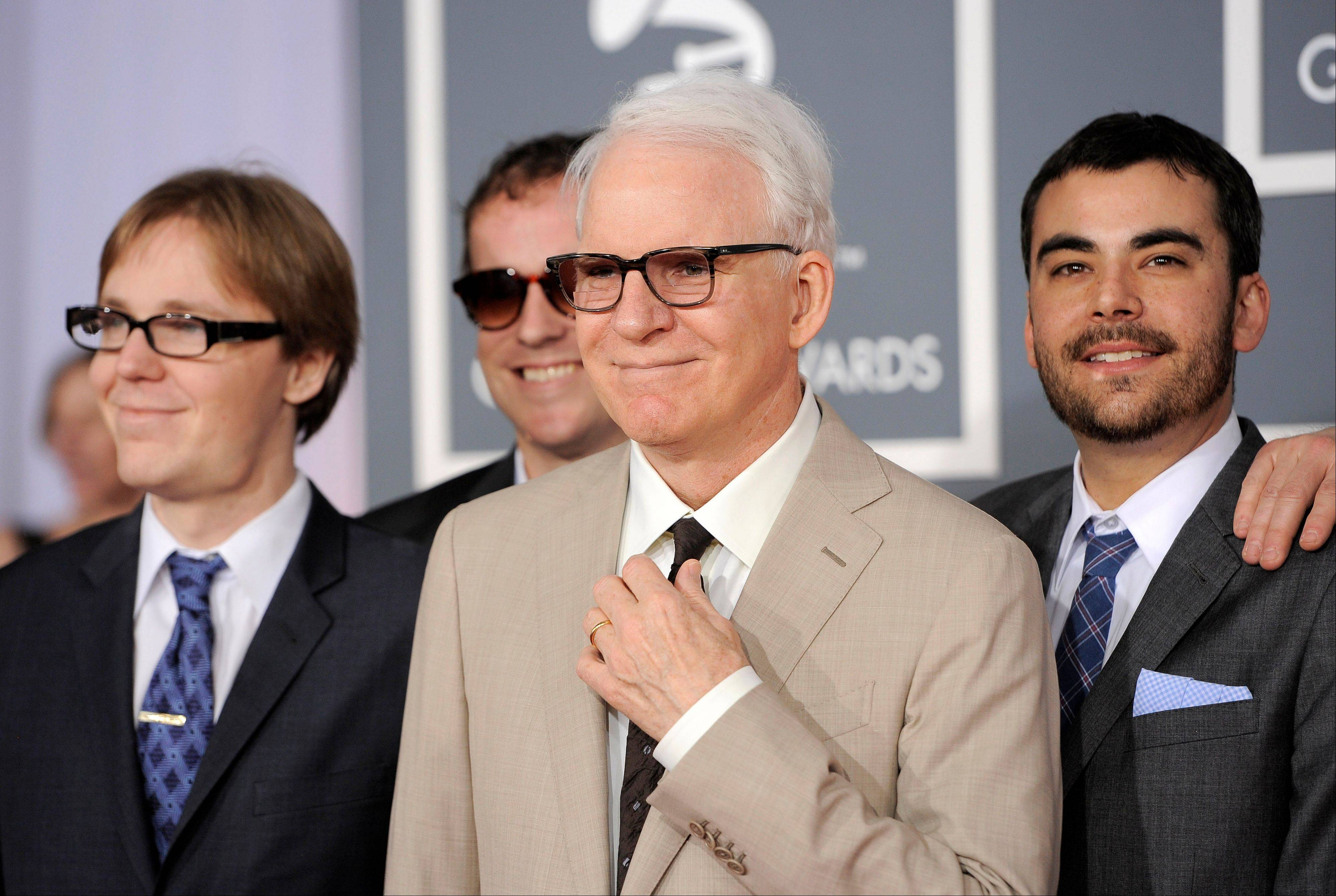 Steve Martin, center, and the Steep Canyon Rangers arrive Sunday at the 54th annual Grammy Awards in Los Angeles.