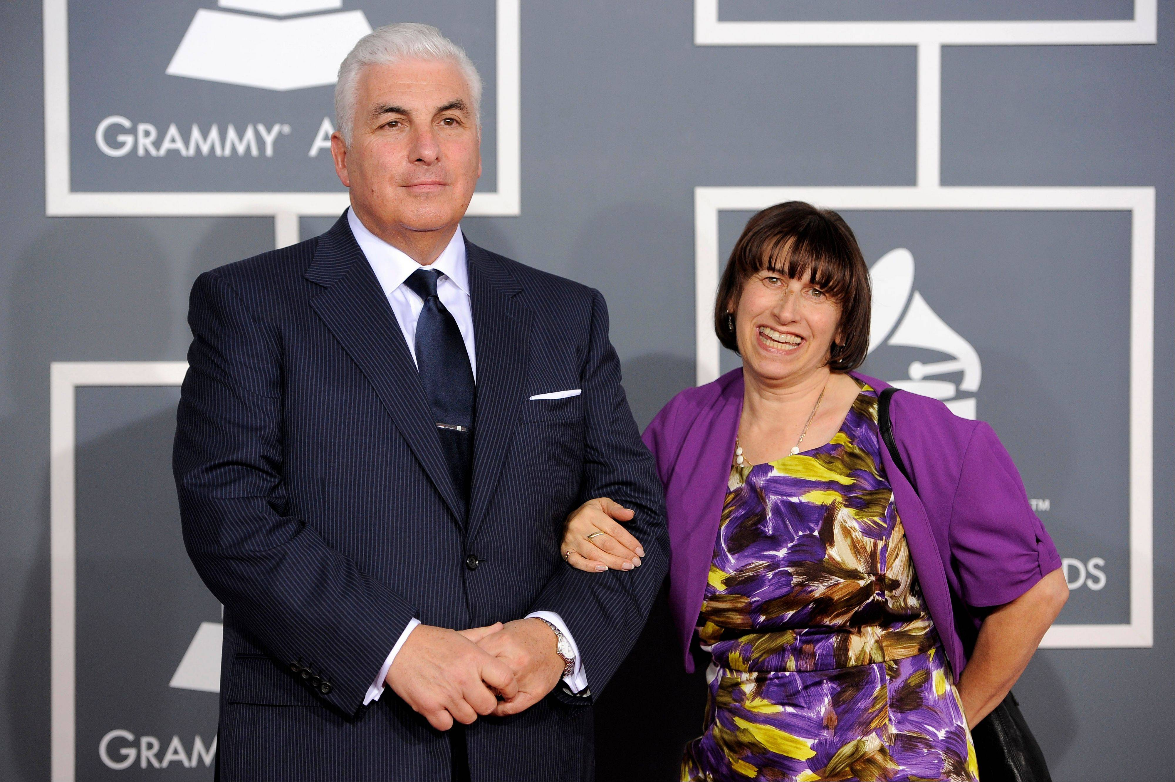 Mitch, left, and Janis Winehouse, parents of the late Amy Winehouse, arrive Sunday at the 54th annual Grammy Awards in Los Angeles.