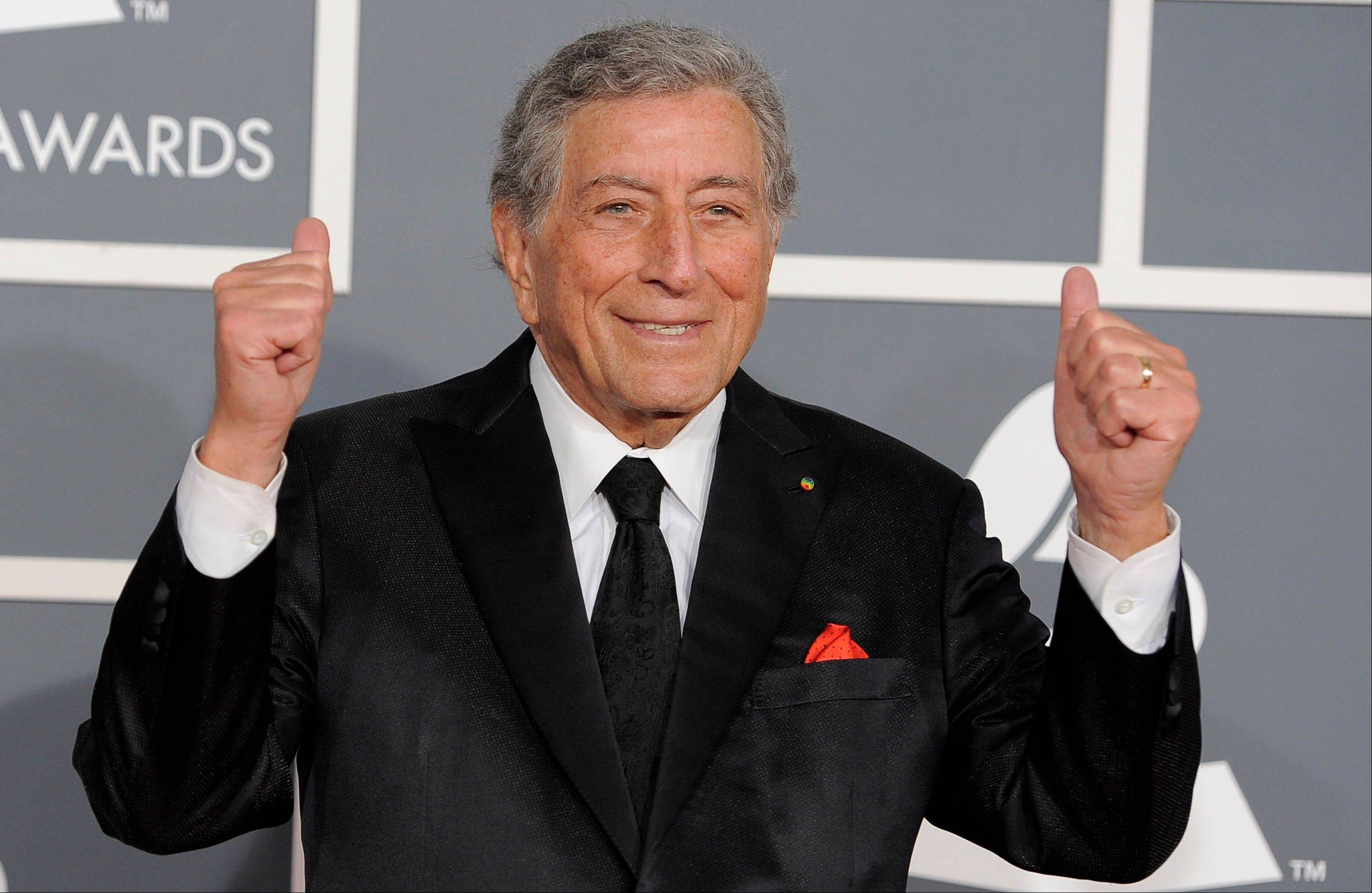 Tony Bennett arrives Sunday at the 54th annual Grammy Awards in Los Angeles.