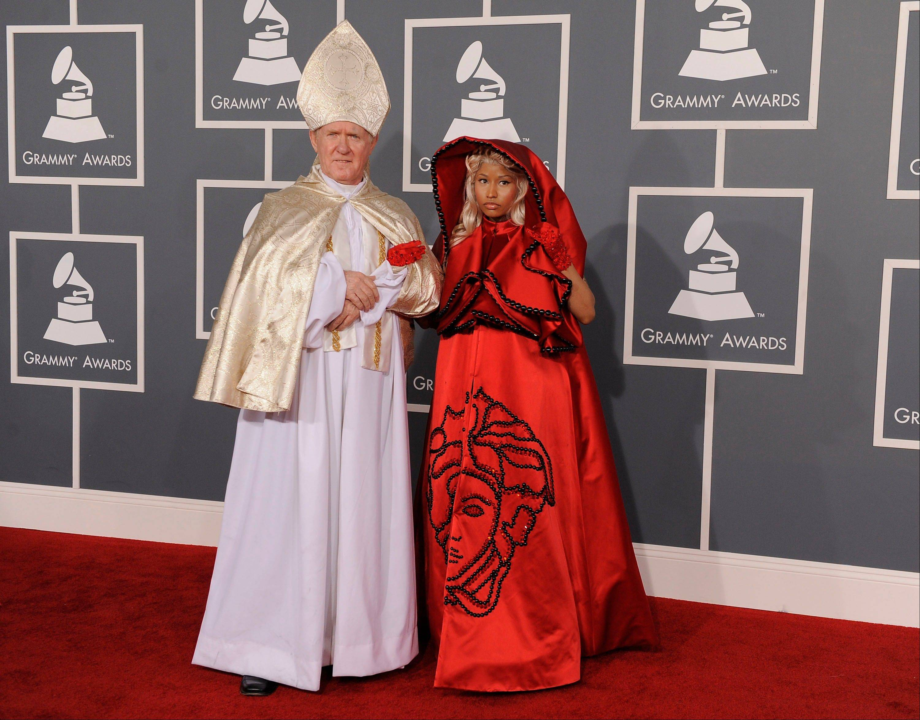 Nicki Minaj, right, and her guest arrive Sunday at the 54th annual Grammy Awards in Los Angeles.