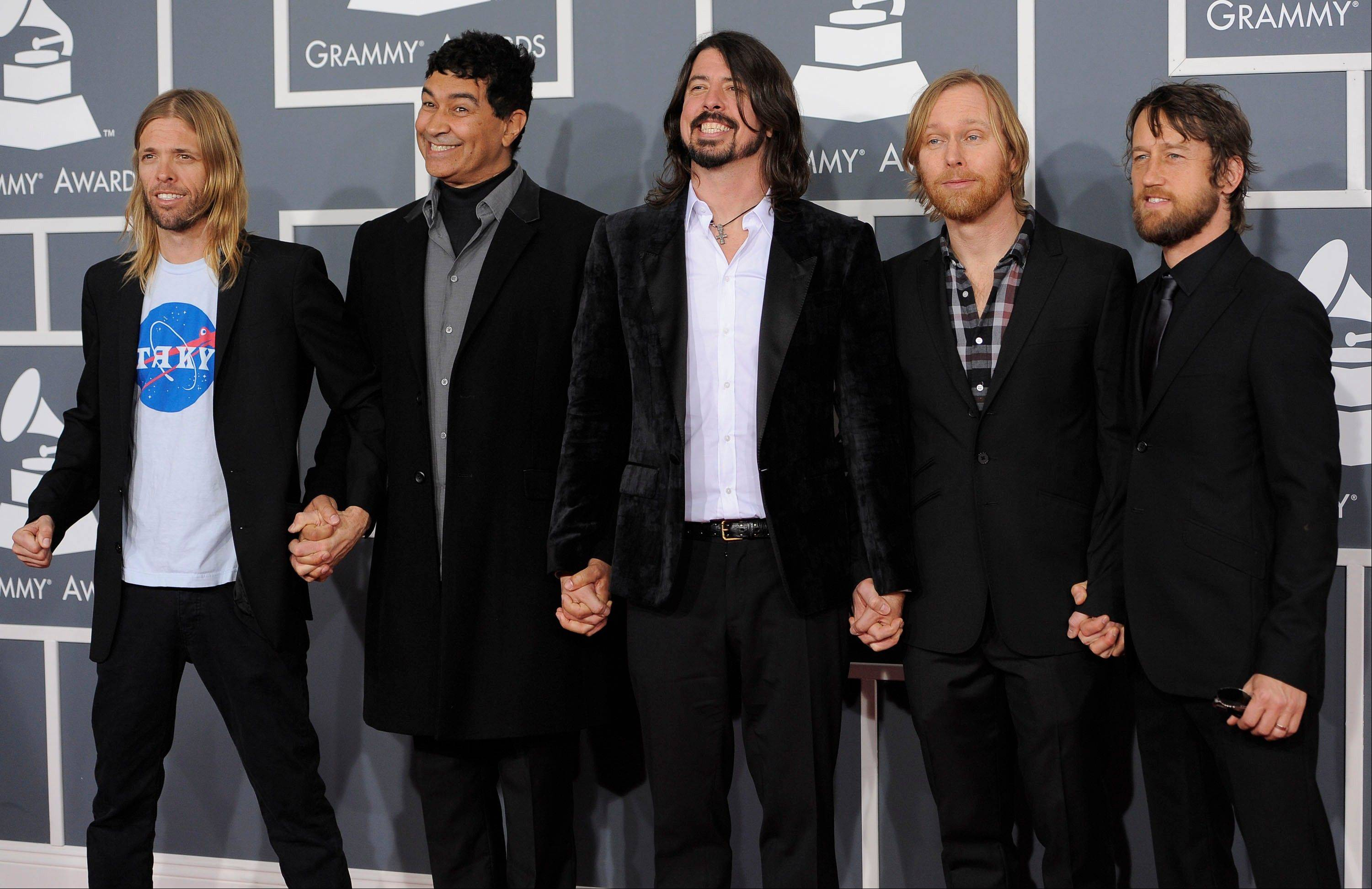 Dave Grohl, third from left, and members of the band Foo Fighters arrive Sunday at the 54th annual Grammy Awards in Los Angeles.