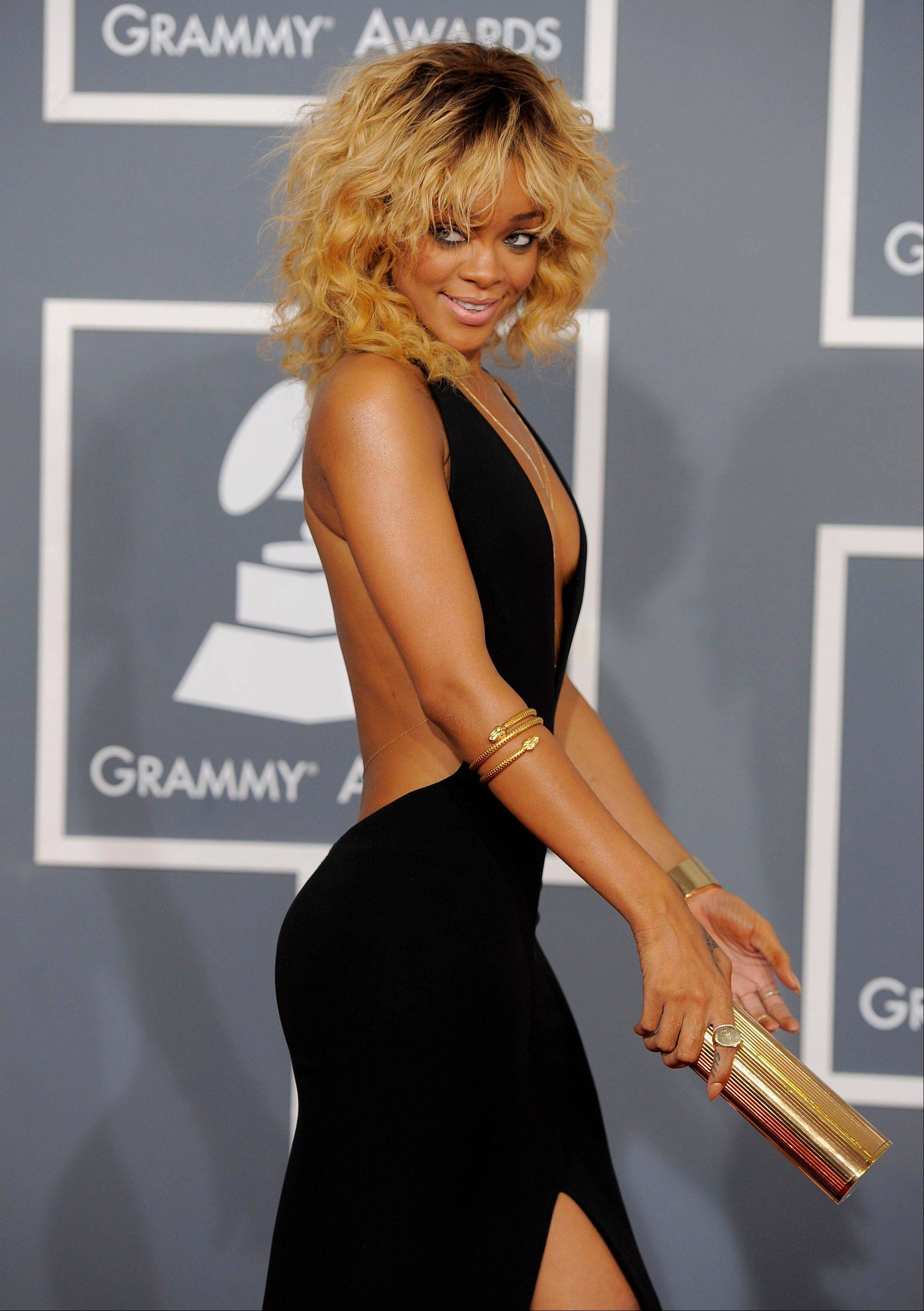 Rihanna arrives Sunday at the 54th annual Grammy Awards in Los Angeles.