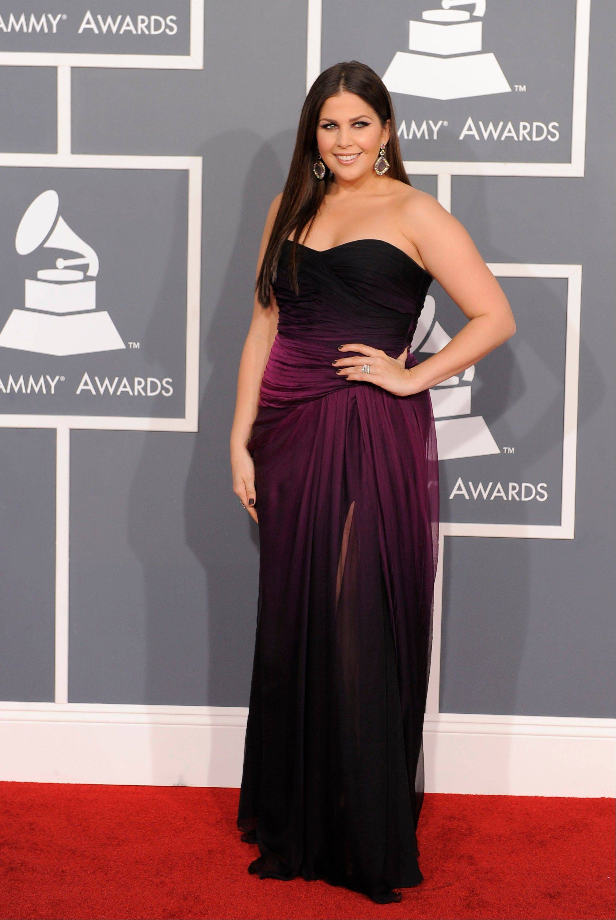 Hillary Scott, of musical group Lady Antebellum, arrives Sunday at the 54th annual Grammy Awards in Los Angeles.