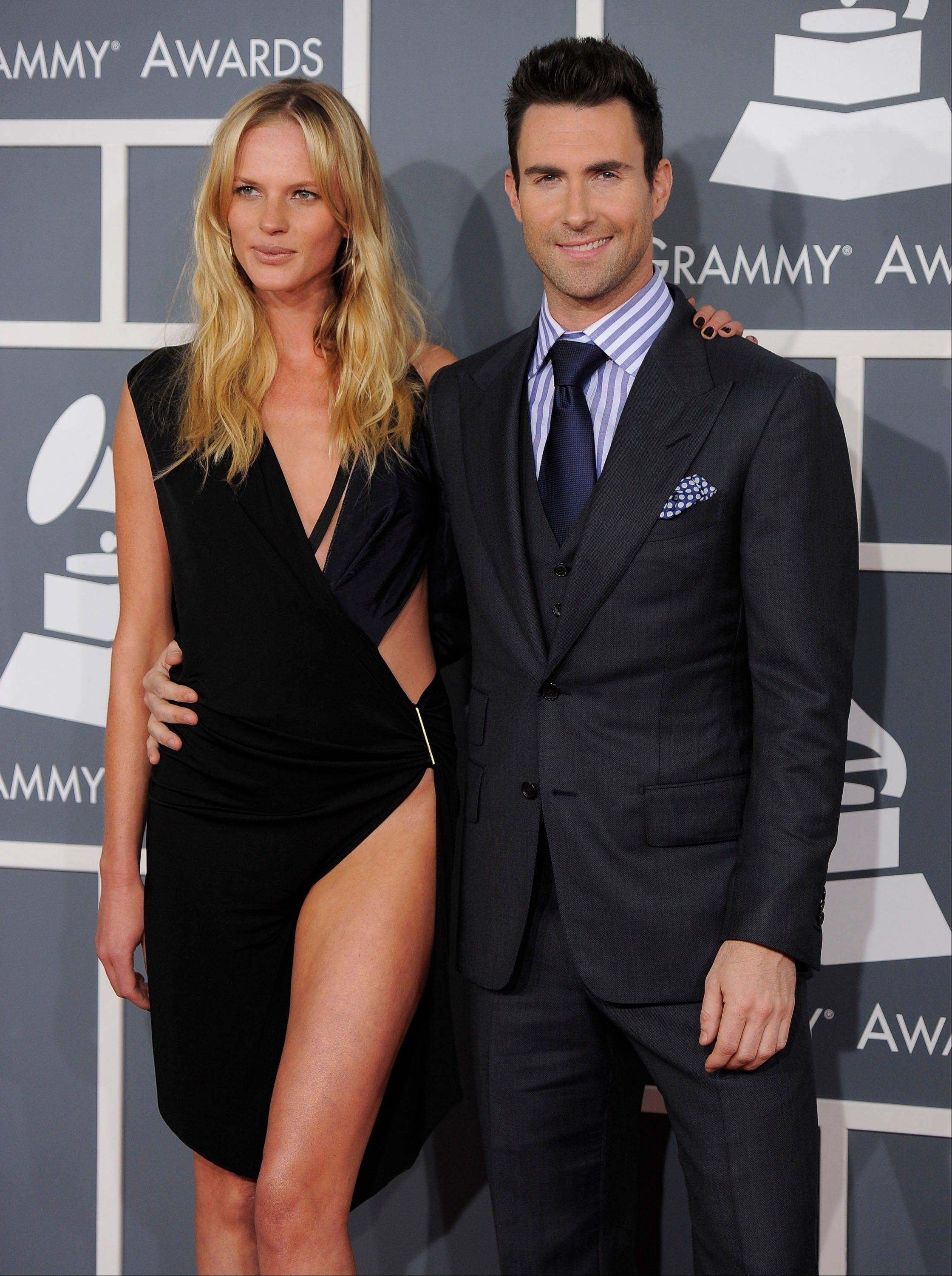 Adam Levine, right, and Anne Vyalitsyna arrive Sunday at the 54th annual Grammy Awards in Los Angeles.