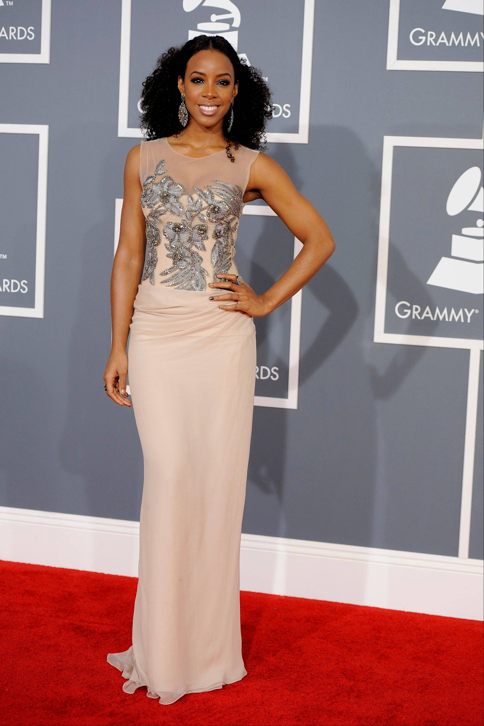 Kelly Rowland arrives Sunday at the 54th annual Grammy Awards in Los Angeles.
