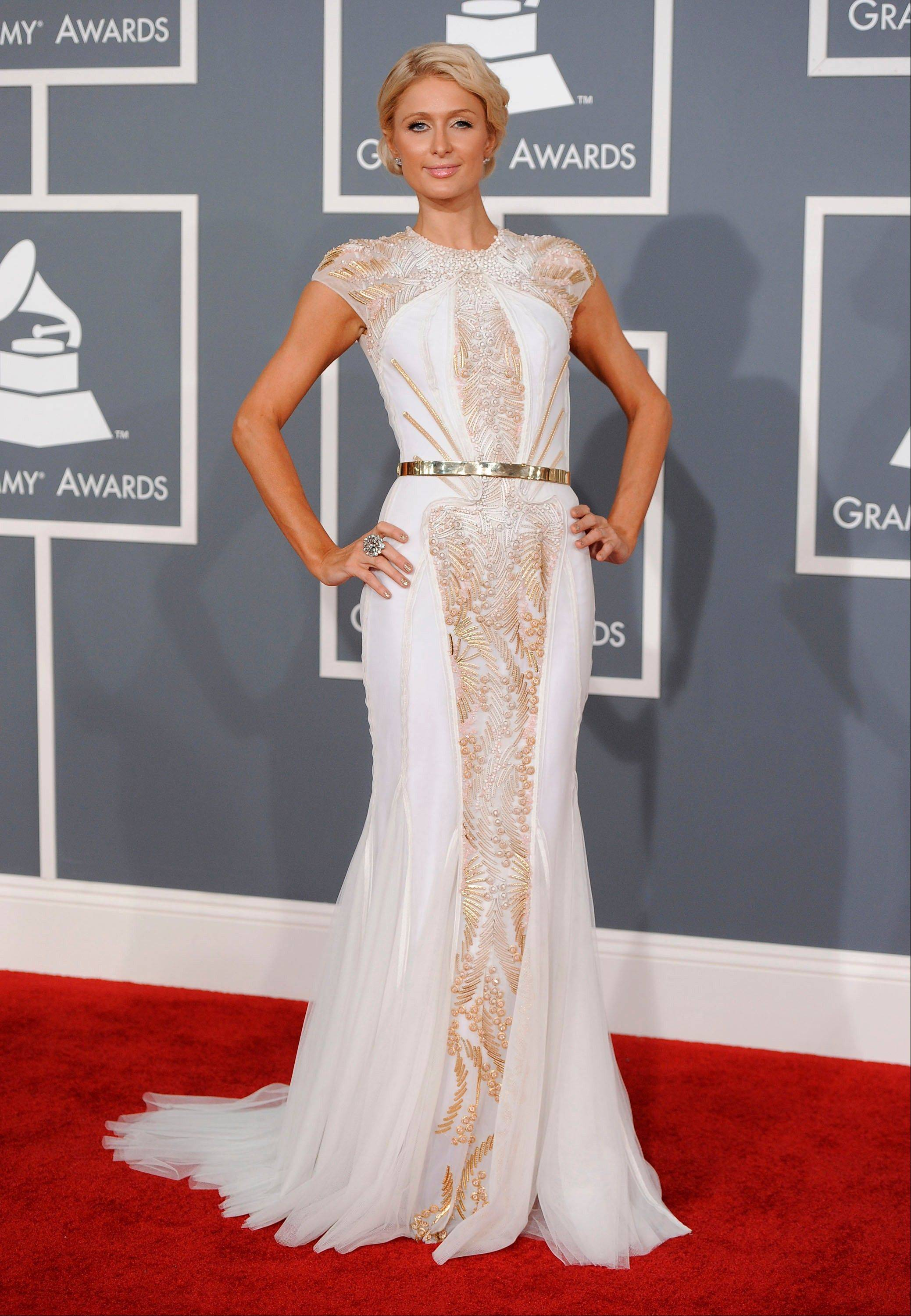 Paris Hilton arrives Sunday at the 54th annual Grammy Awards in Los Angeles.