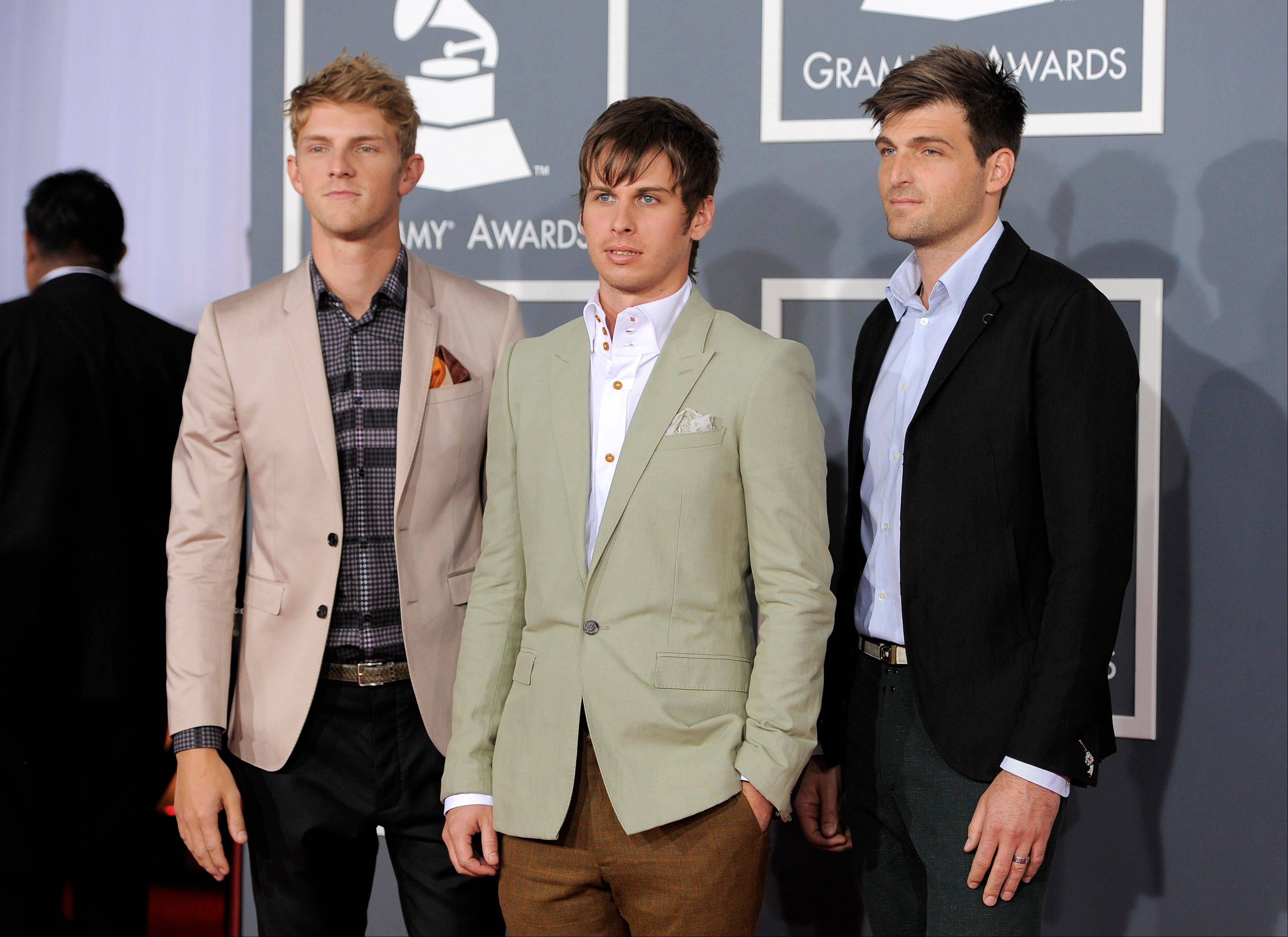 The band Foster the People arrives Sunday at the 54th annual Grammy Awards in Los Angeles.