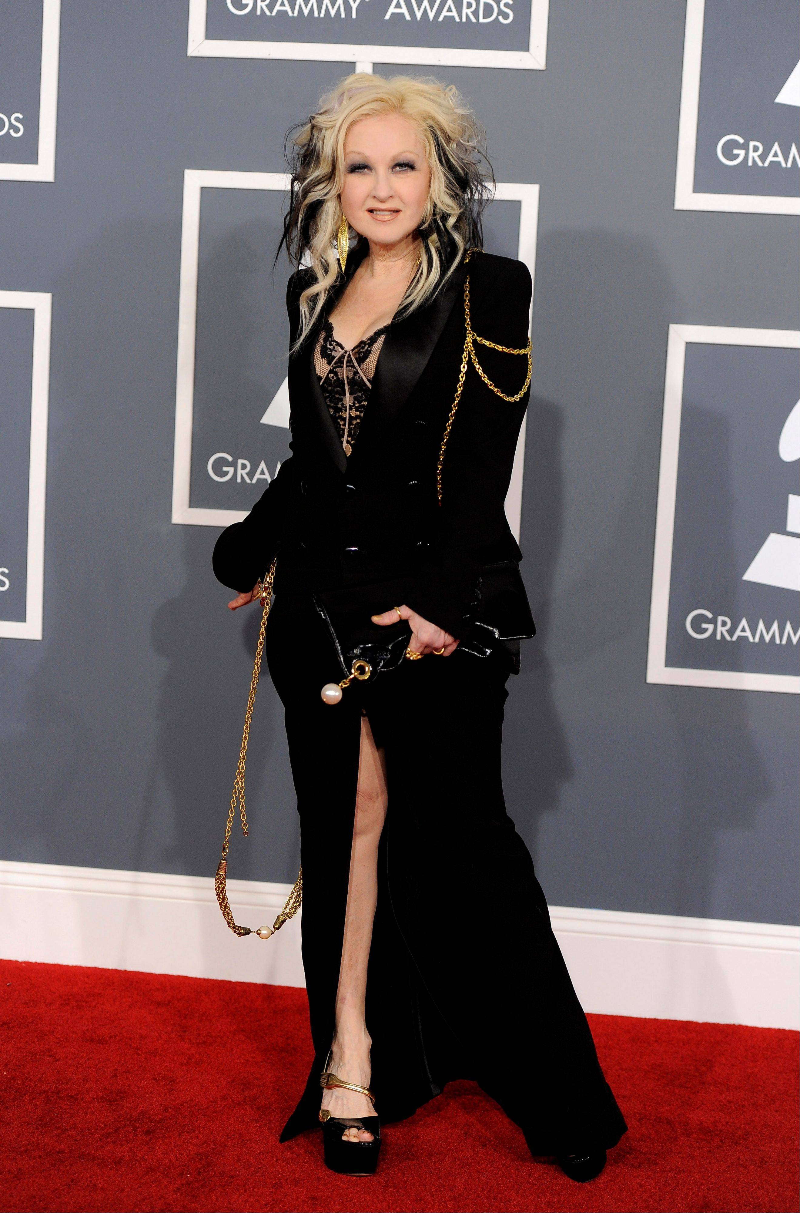 Cyndi Lauper arrives Sunday at the 54th annual Grammy Awards in Los Angeles.
